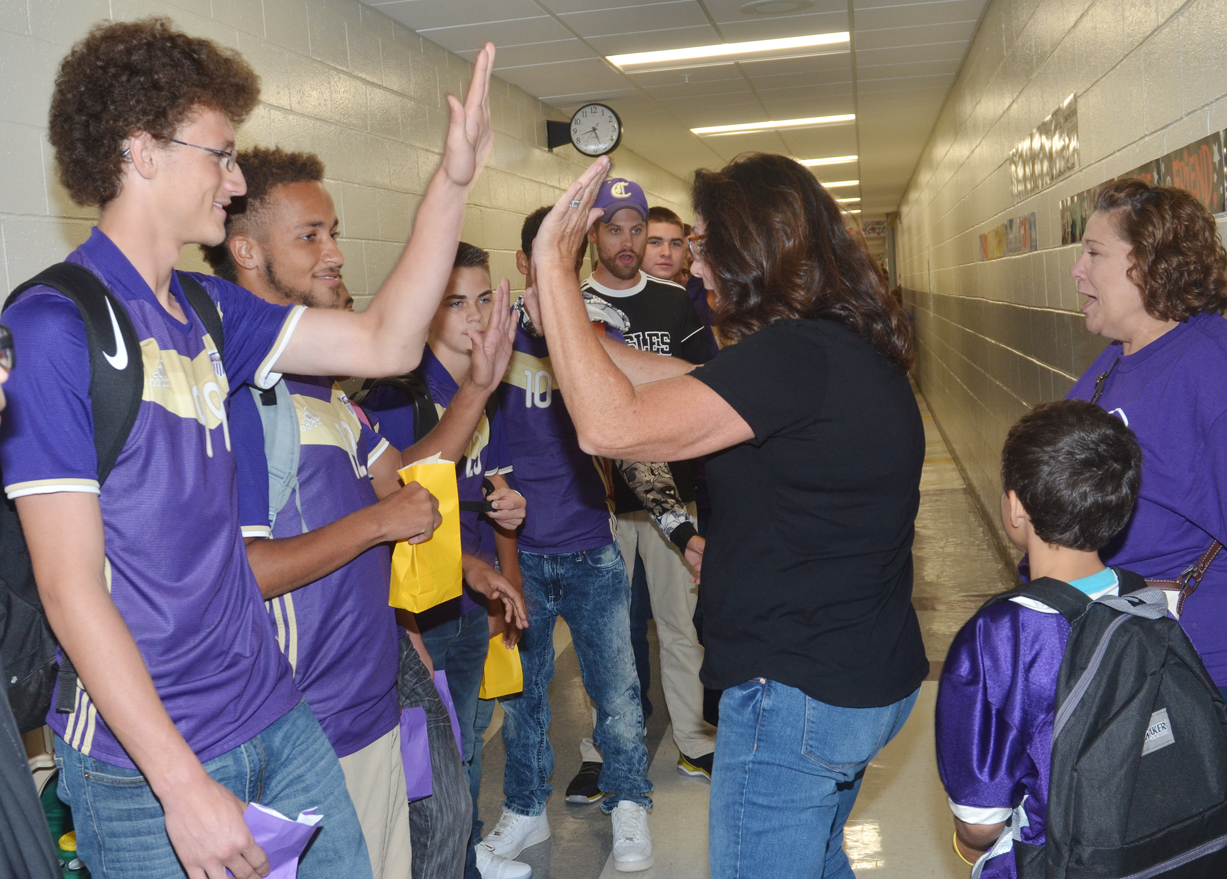 CHS sophomore Brennon Wheeler high fives CES teacher Patty Haley.