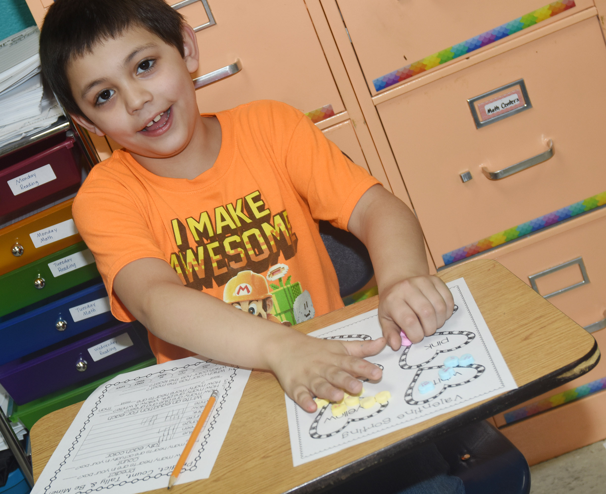 CES first-grader Keagan Shearer sorts his hearts.