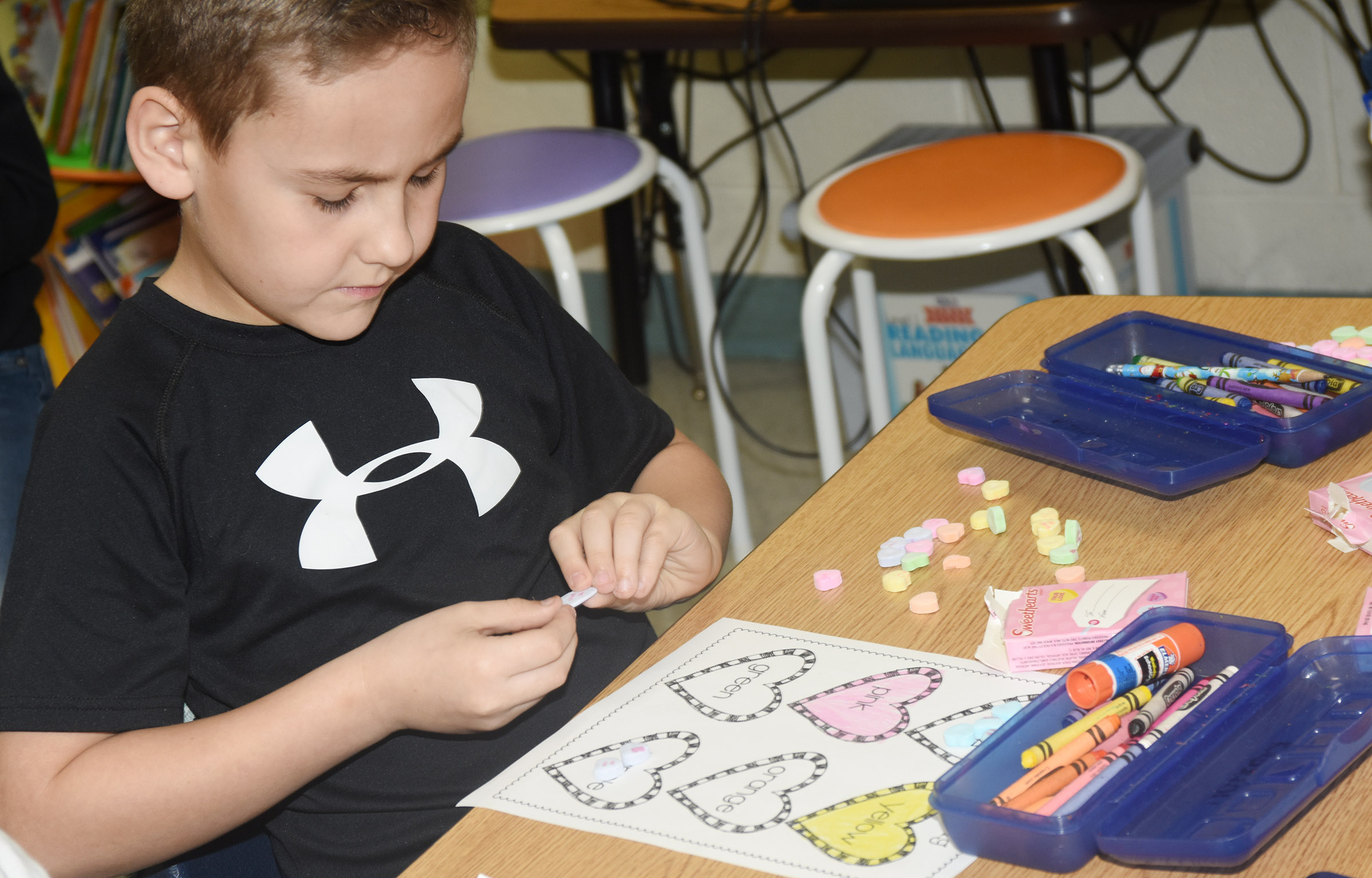 CES first-grader Braxton Rhodes sorts his hearts.
