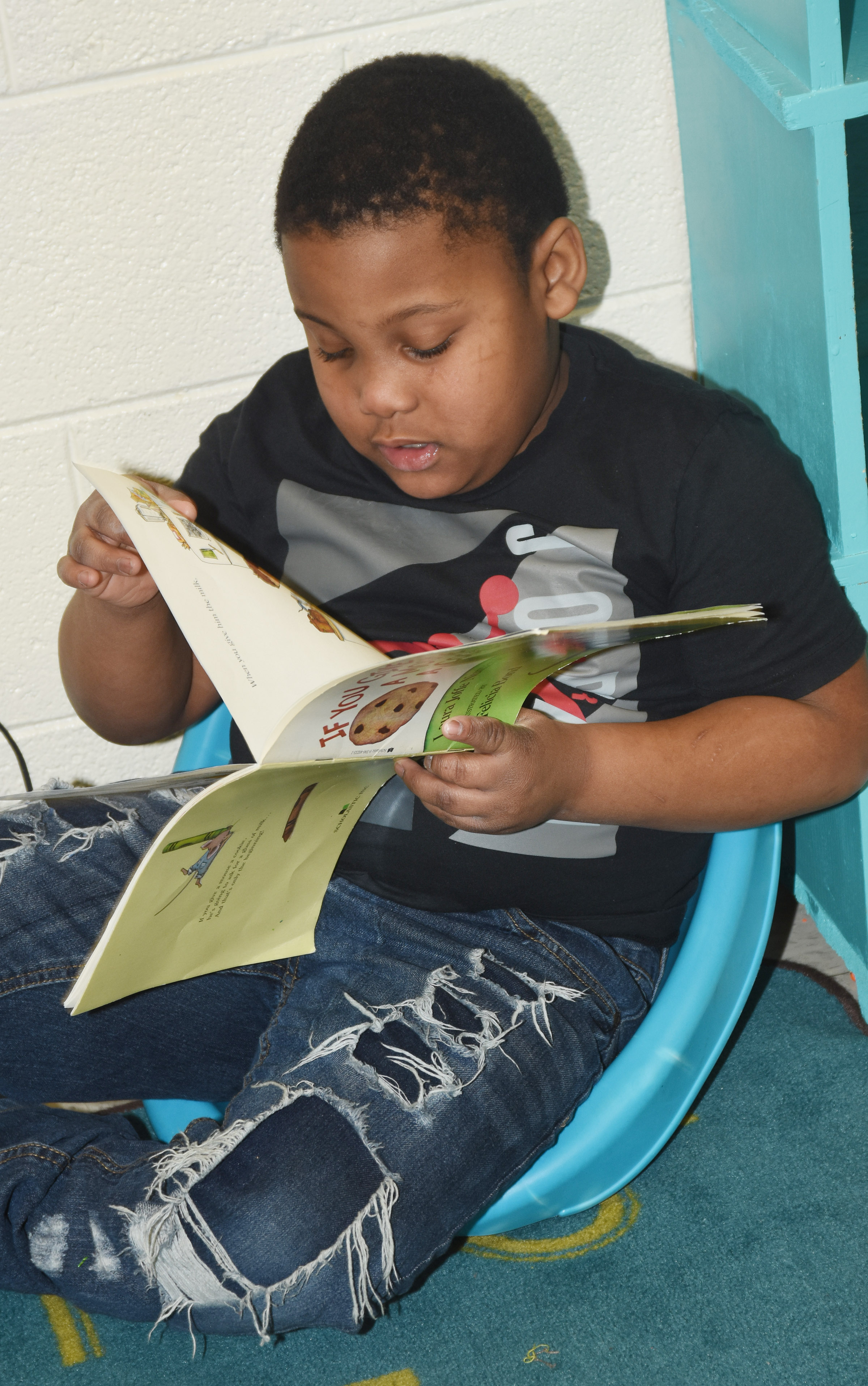 CES first-grader Malachi Conner reads.