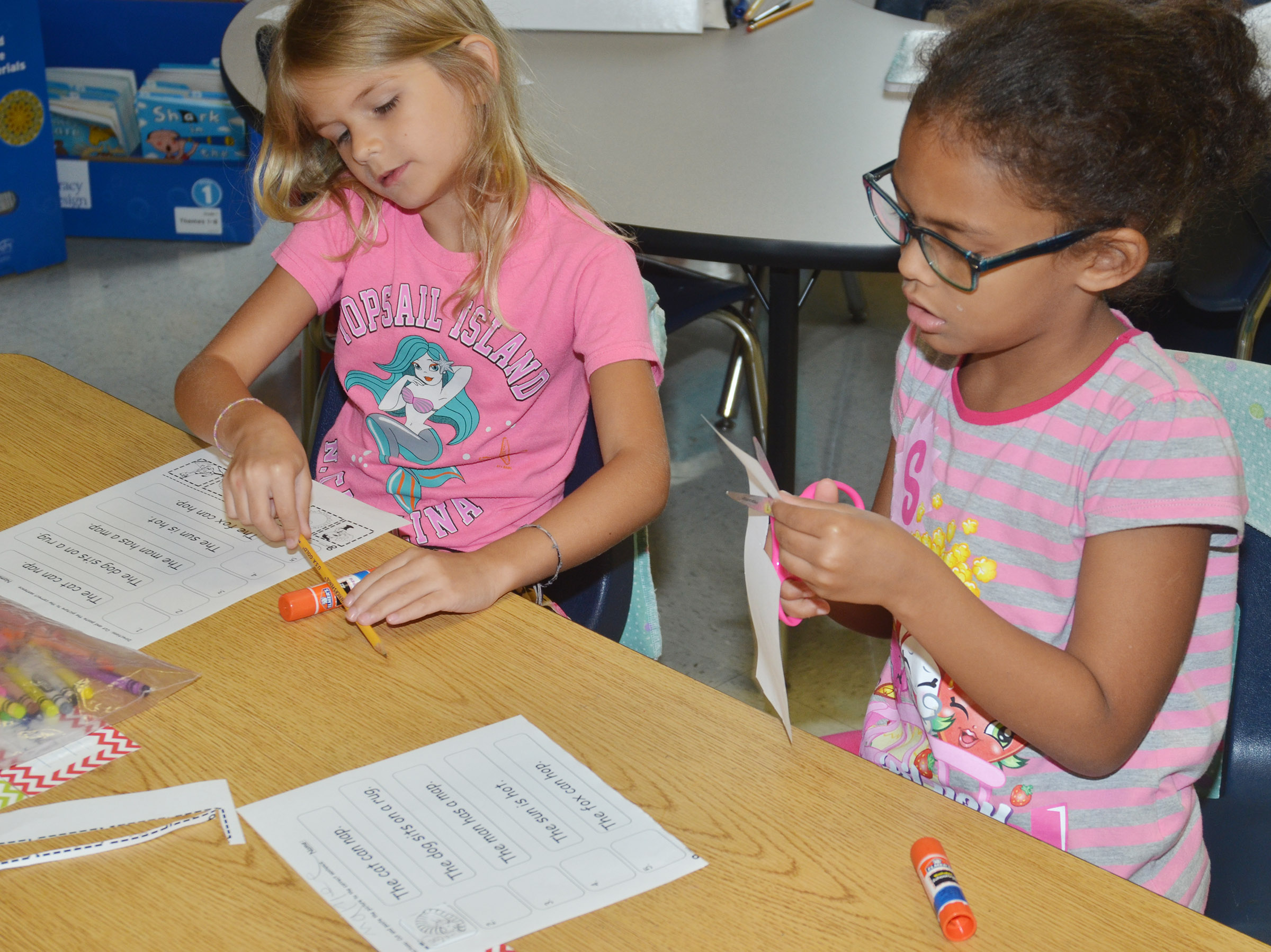 CES first-graders Gracie Gebler, at left, and Marlee Dickens work on their worksheets.