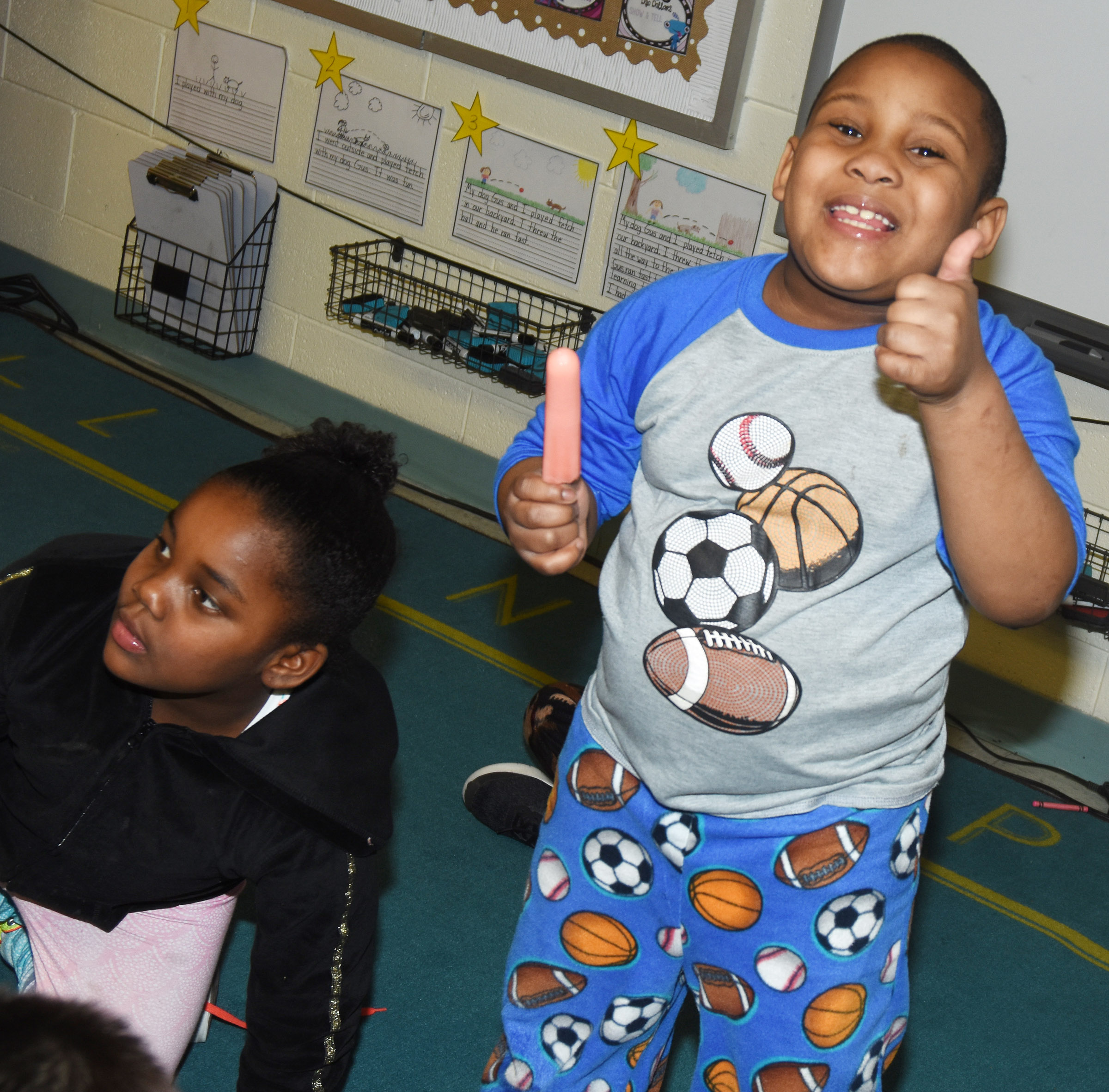 CES first-grader Malachi Conner enjoys his Popsicle as classmate Destinee Henry-Turner waits for hers.