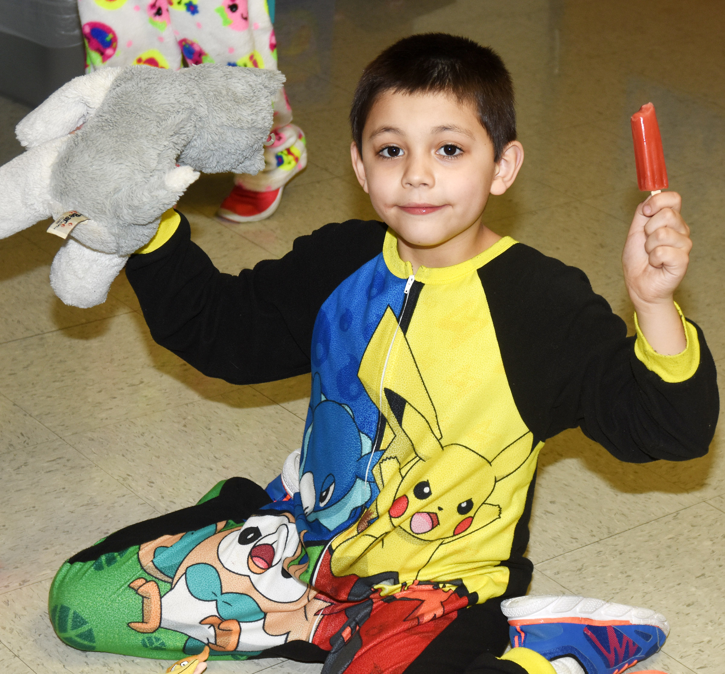 CES first-grader Keagan Shearer eats his Popsicle while wearing his pajamas.
