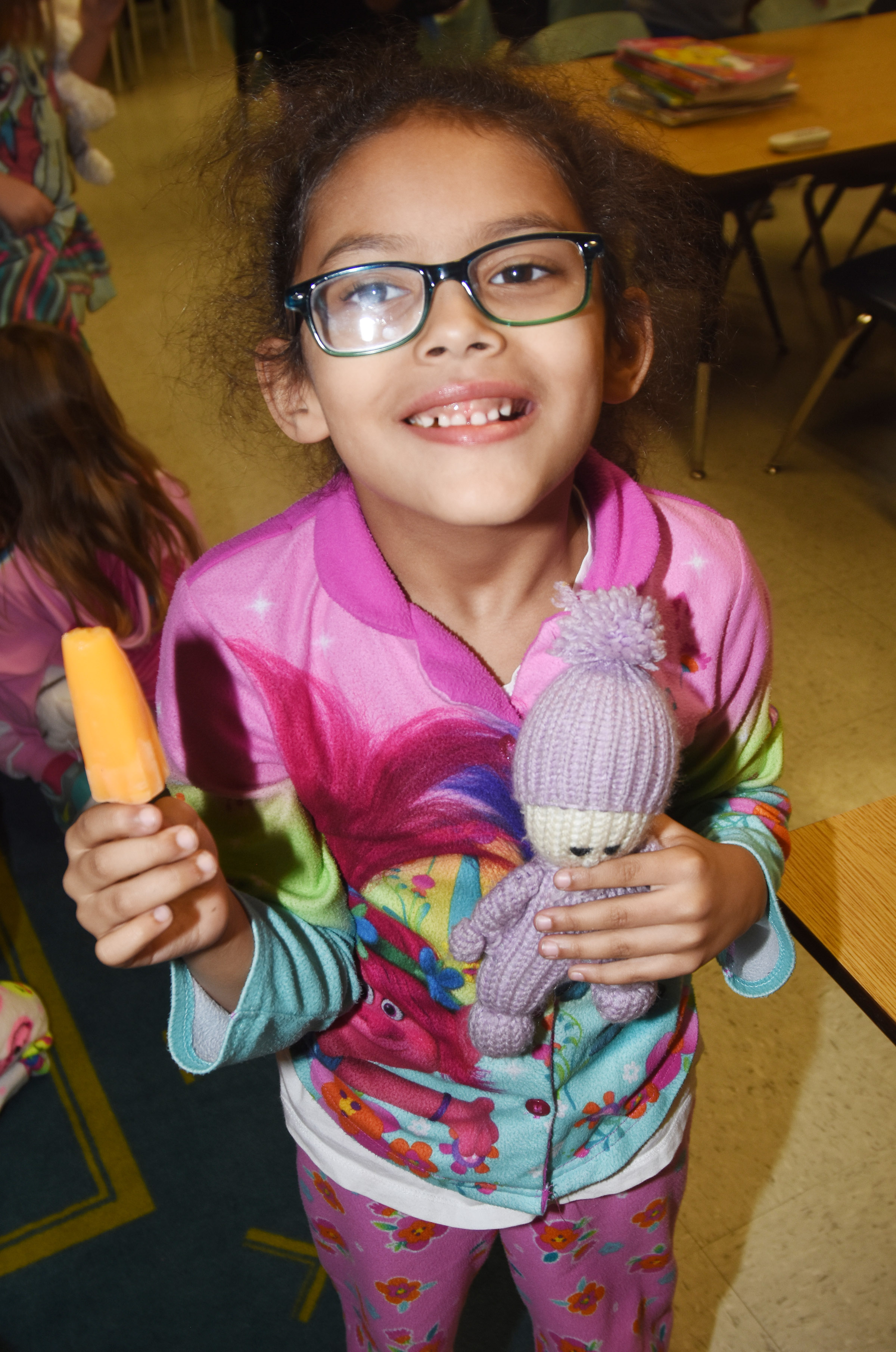 CES first-grader Marlee Dickens enjoys her Popsicle.