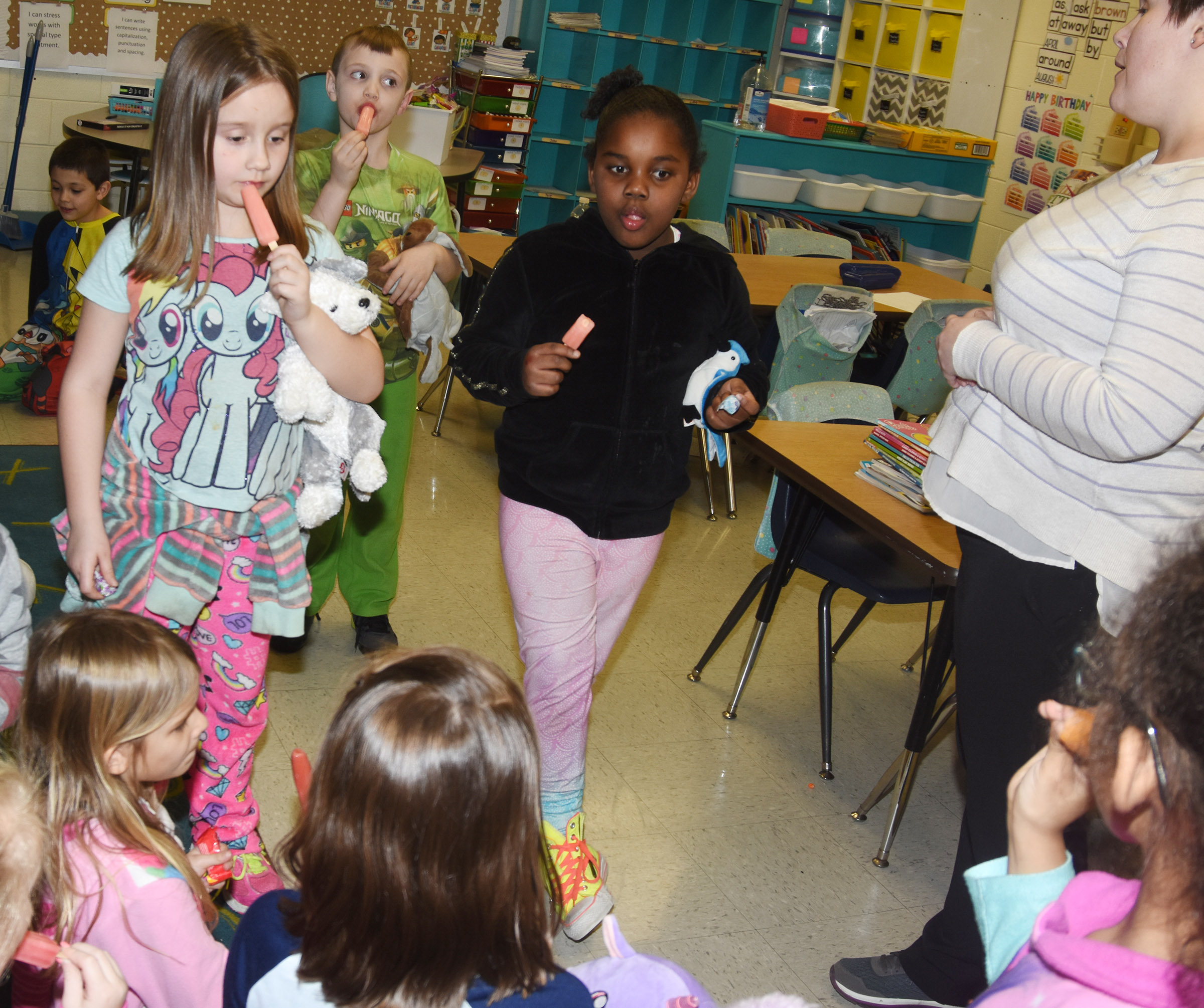 CES first-graders in Amanda Barnett's class enjoy their pajama party, made complete with Popsicles. From left are Natalee Shaw, John Lane and Destinee Henry-Turner.