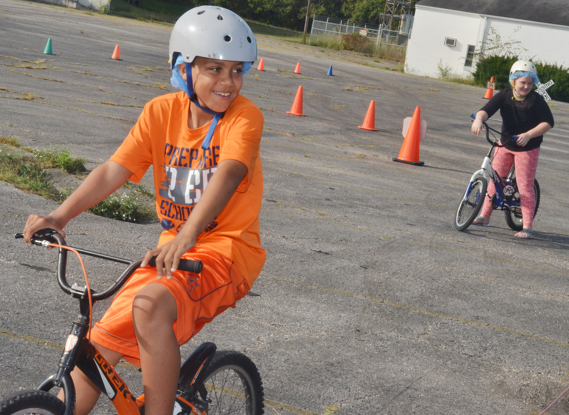 CES fourth-grader Christian Hart obeys bicycle rules.