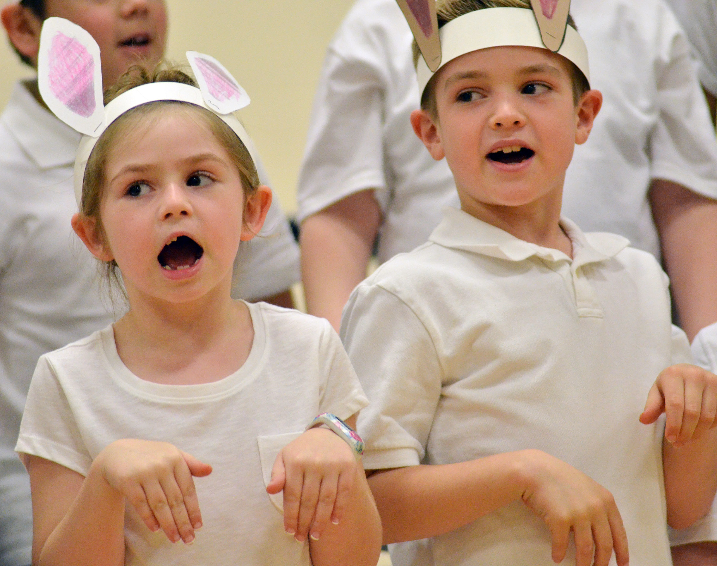 CES first-graders Lainey Price, at left, and Dax Gray sing.
