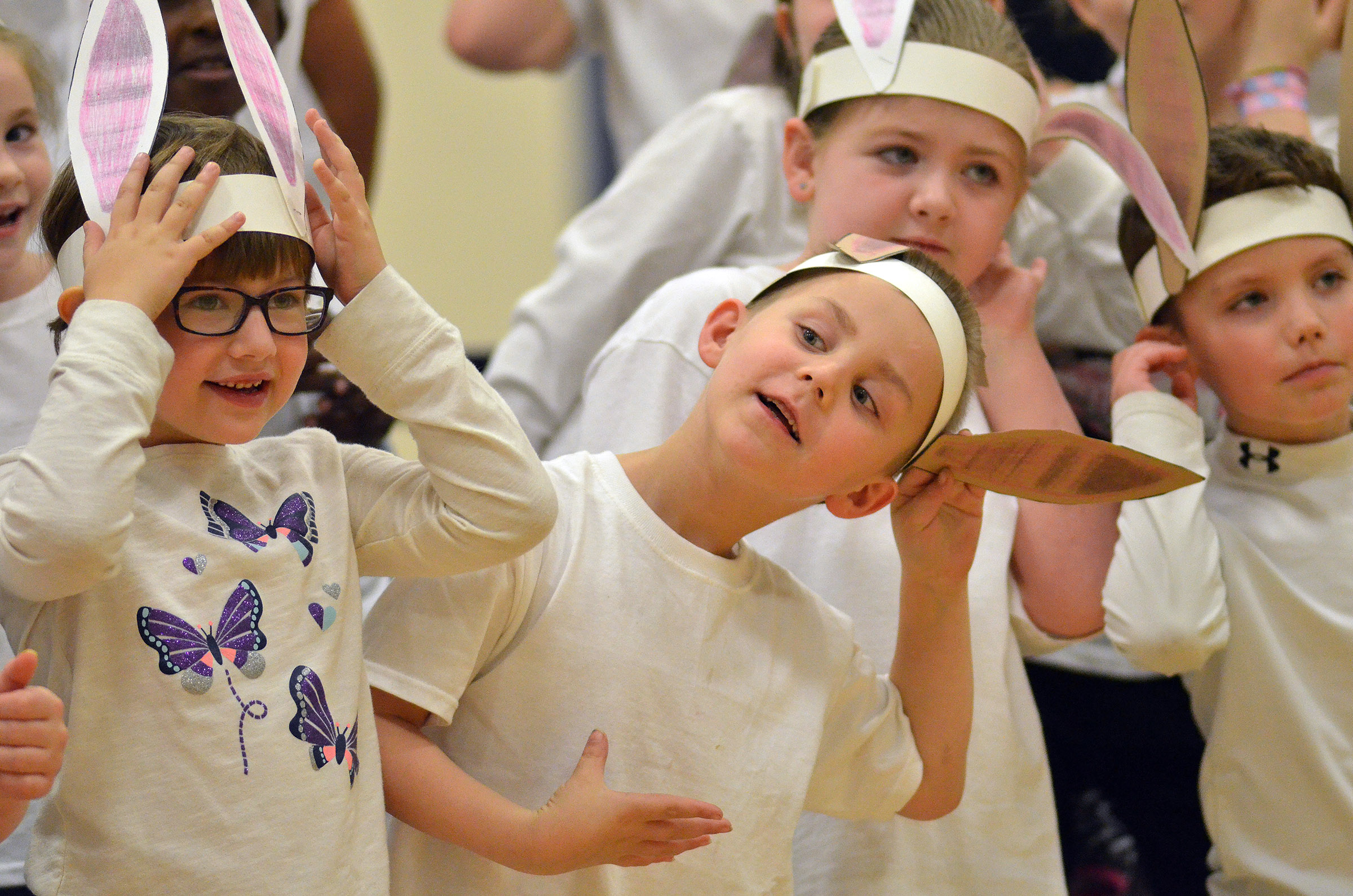 CES first-graders Addelyn Dooley, at left, and Jackson Bates sing.