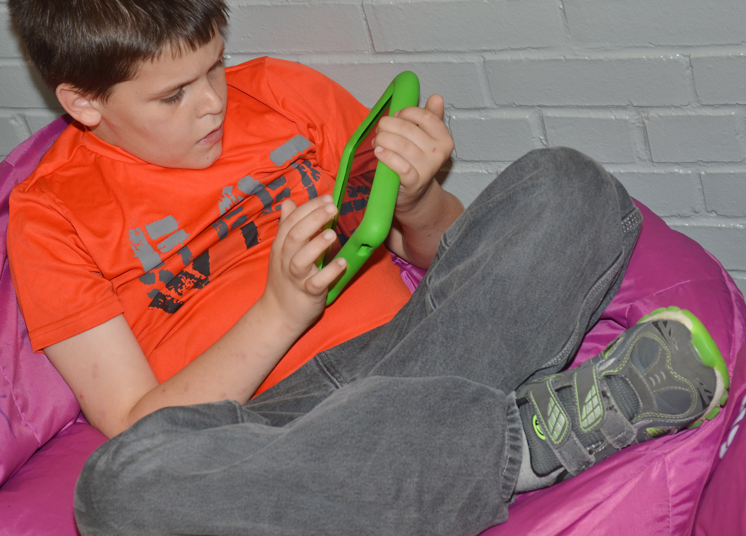 CES fourth-grader Chris Brown uses a Kindle to work math problems via Star Math.