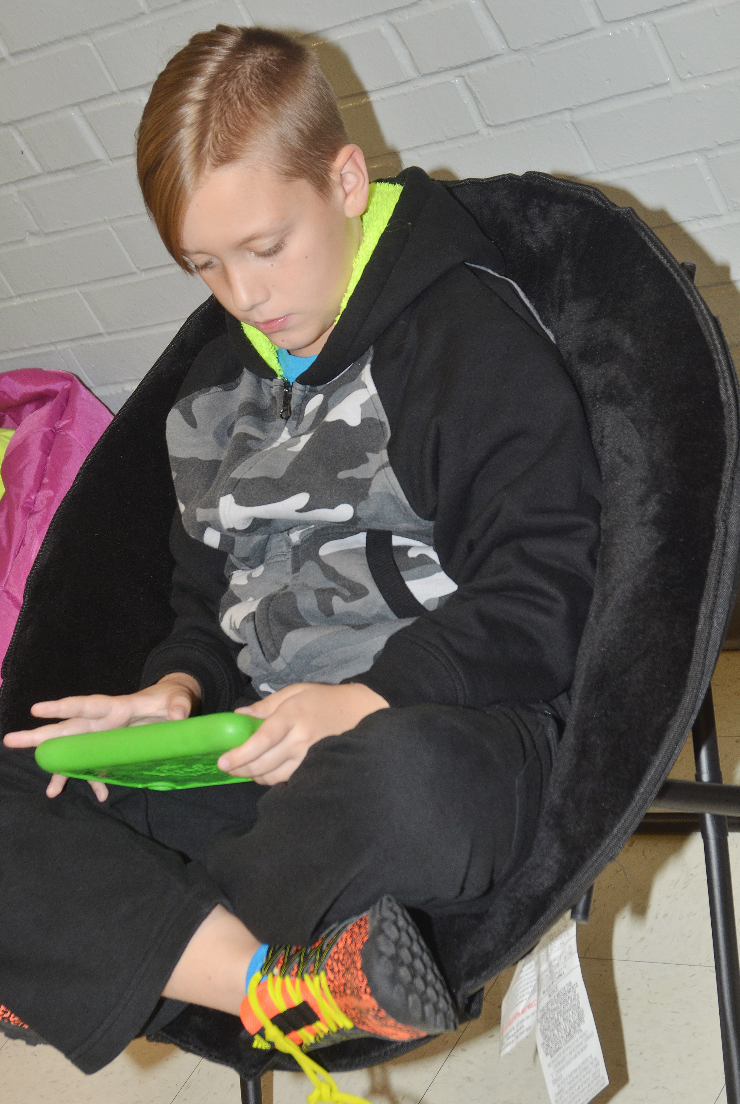 CES fourth-grader Izak Burress uses a Kindle to work math problems via Star Math.