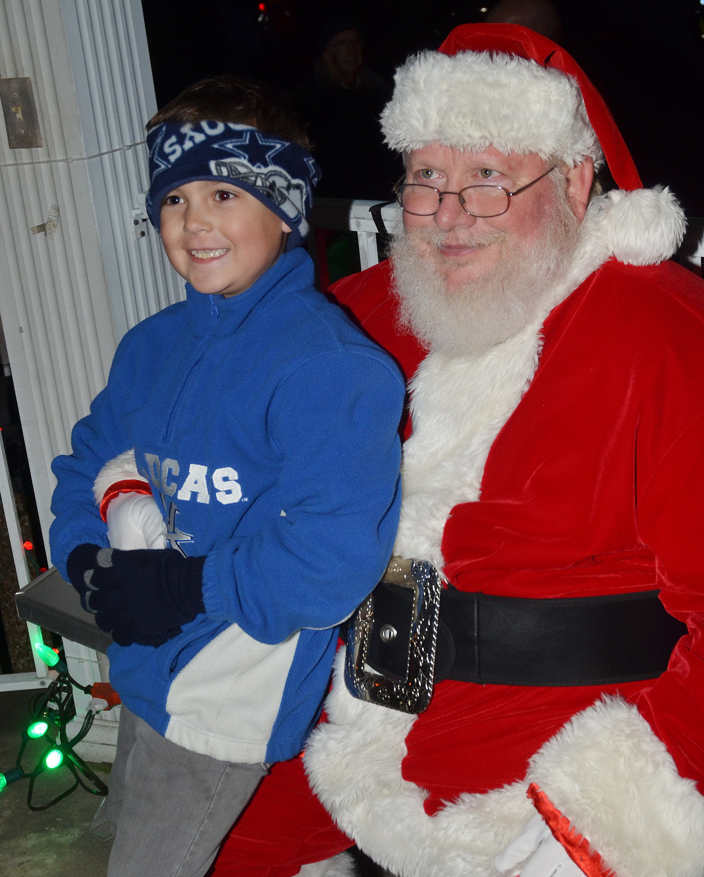 CES second-grader Brendan Martin smiles for a photo with Santa.