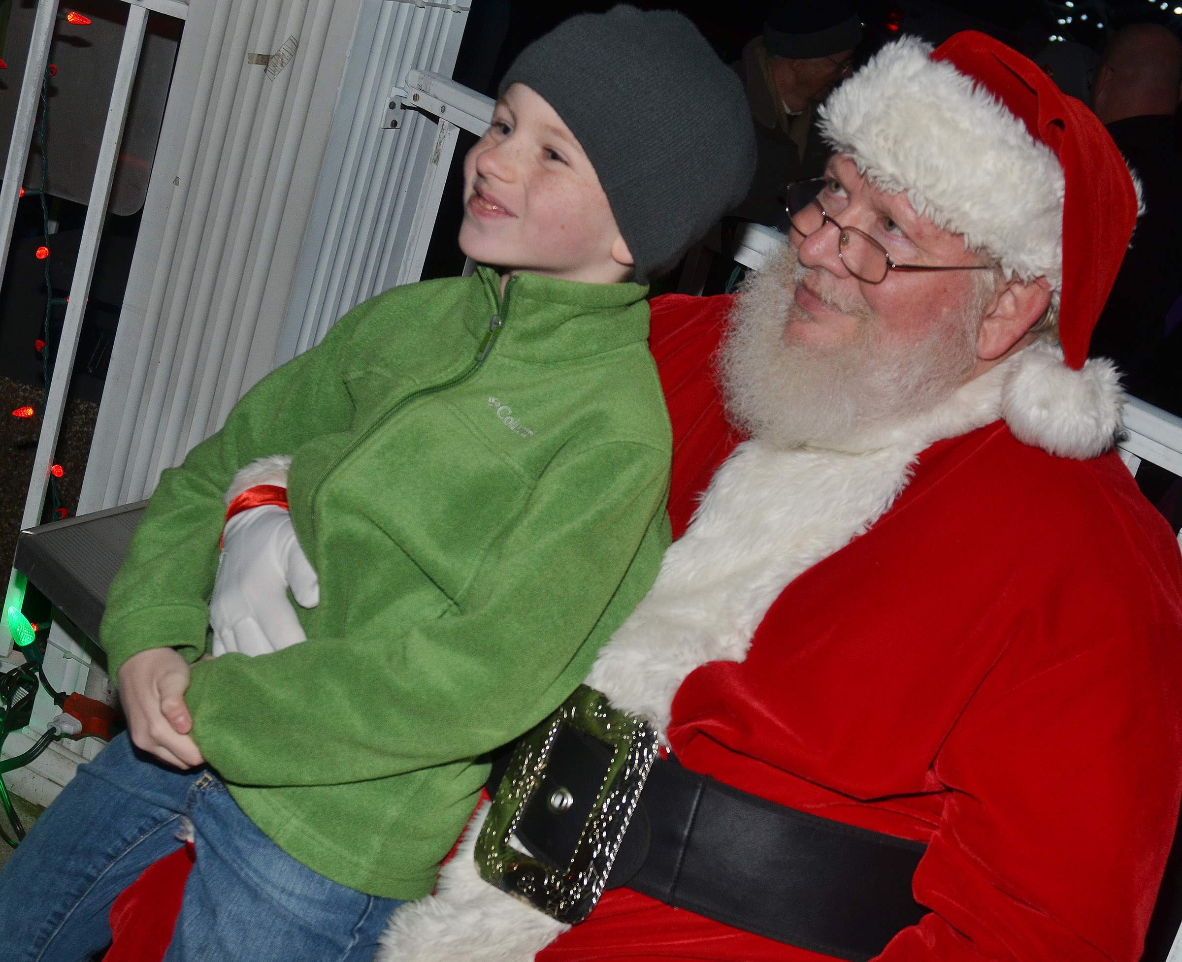CES second-grader Jayden Cox smiles for a photo with Santa.