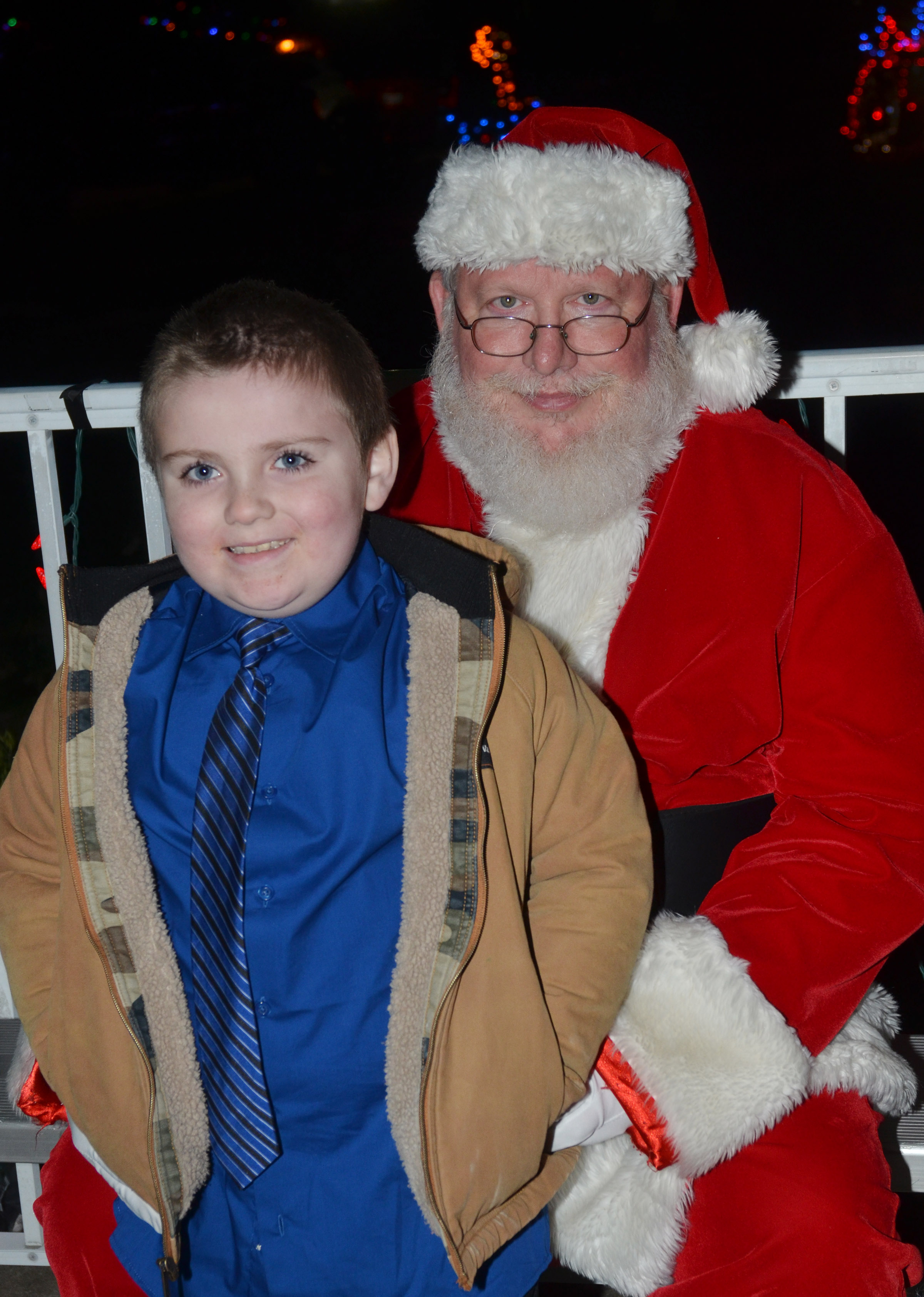 CES second-grader Drake Edwards smiles for a photo with Santa.