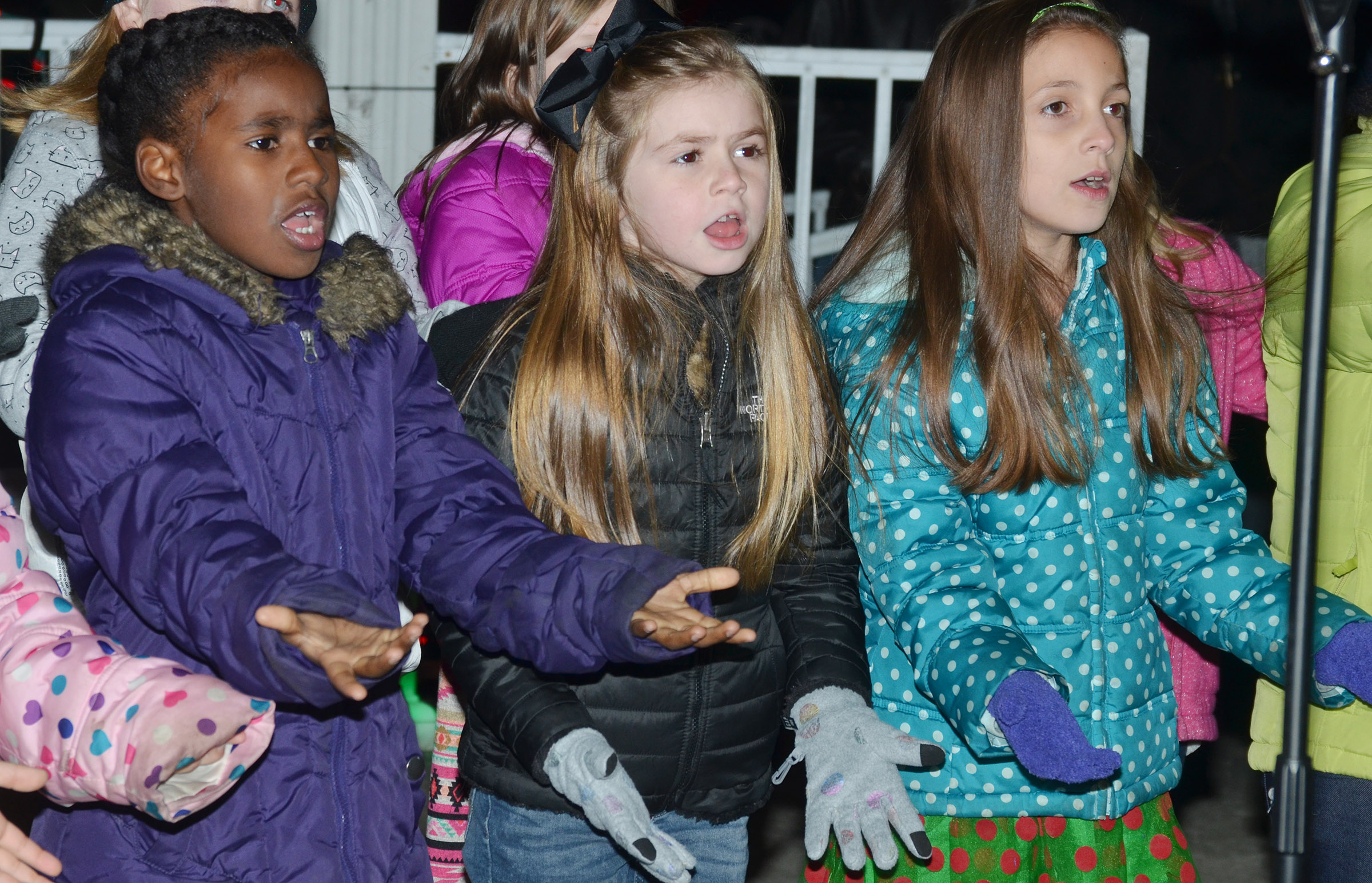 CES second-graders Destini Gholston, Lainey Price and Lillian Martin sing.