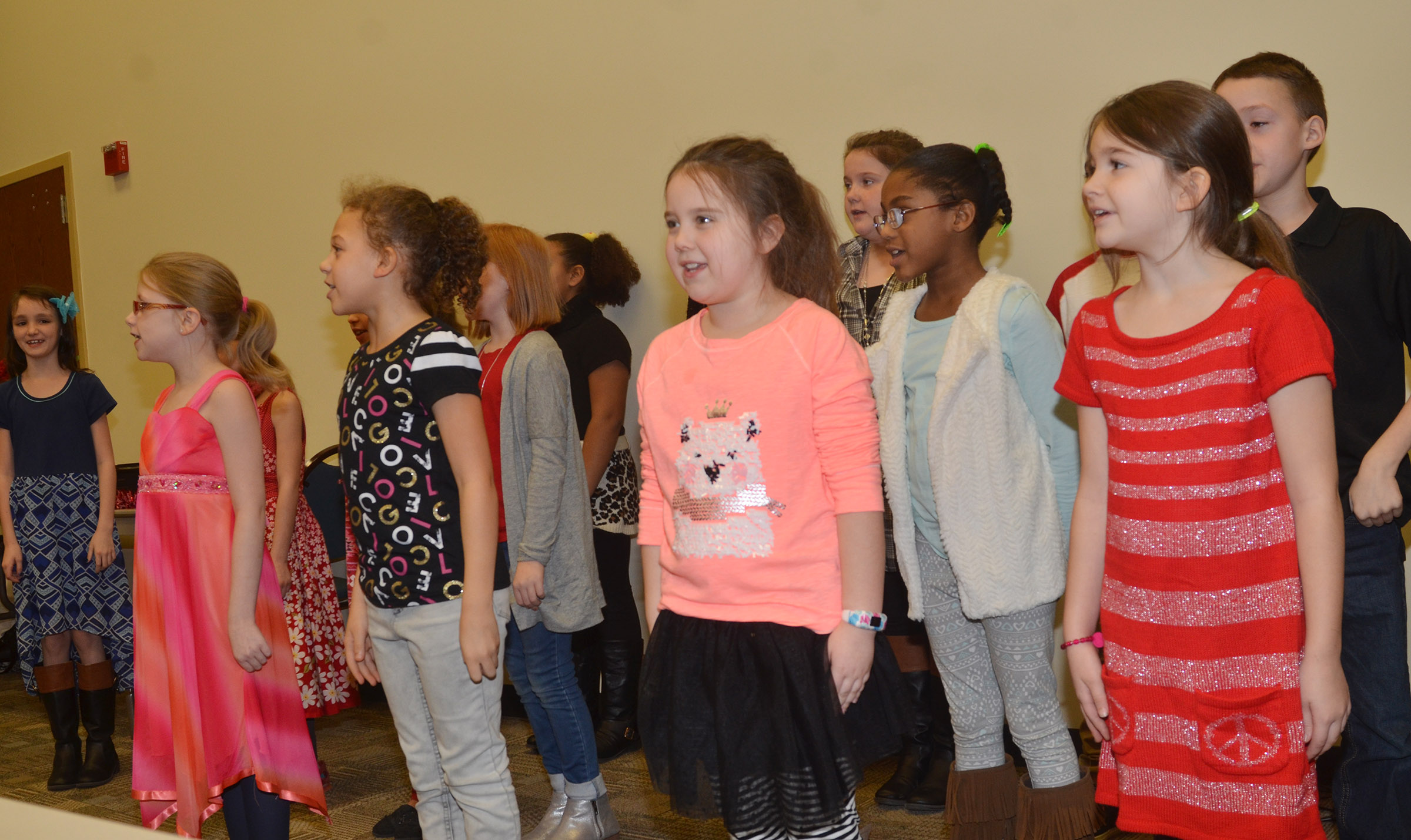 CES third-graders Maylee Wilds, center, and Destiny Abell perform with their choir.