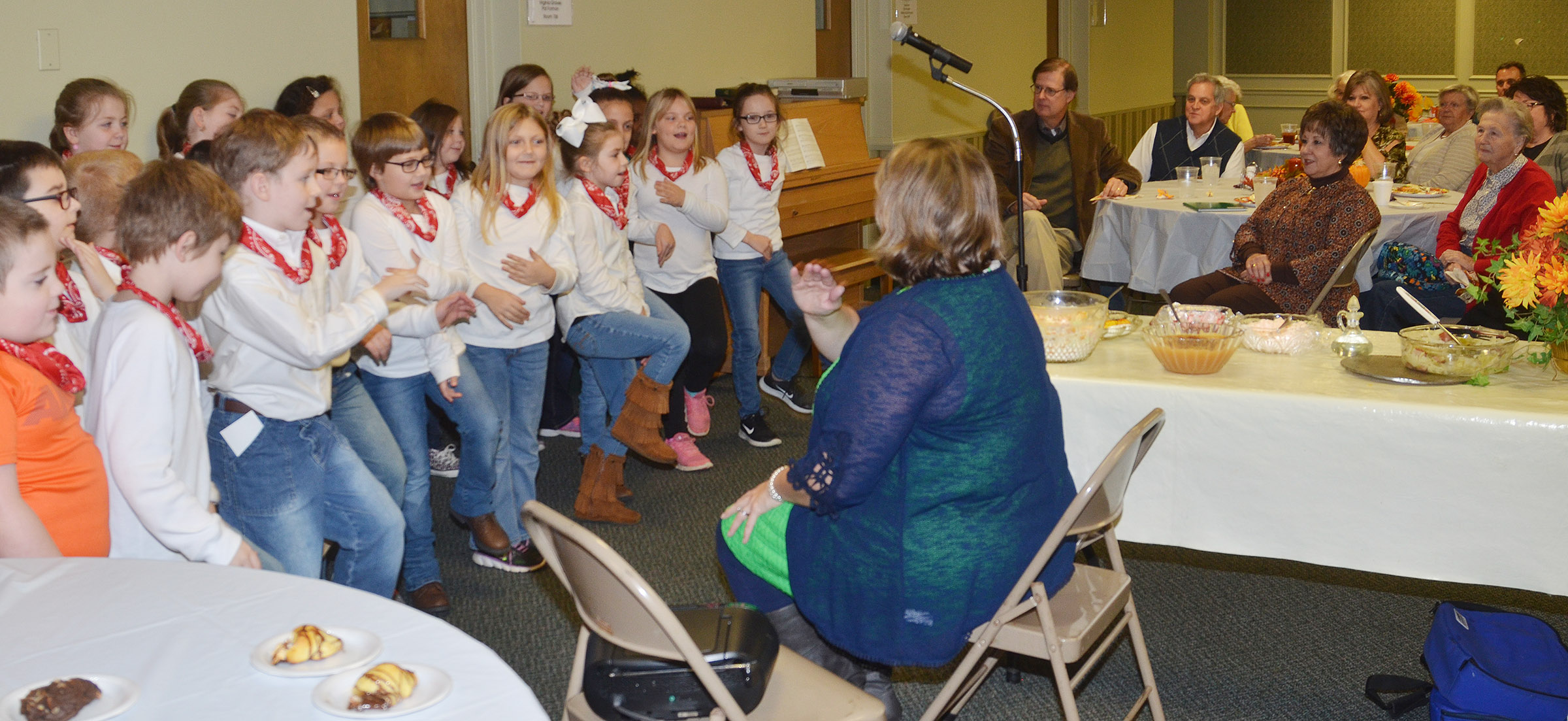 CES second-grade choir members perform for Campbellsville Baptist Church's Young at Heart group. Cyndi Chadwick, CES music teacher, directs the group.