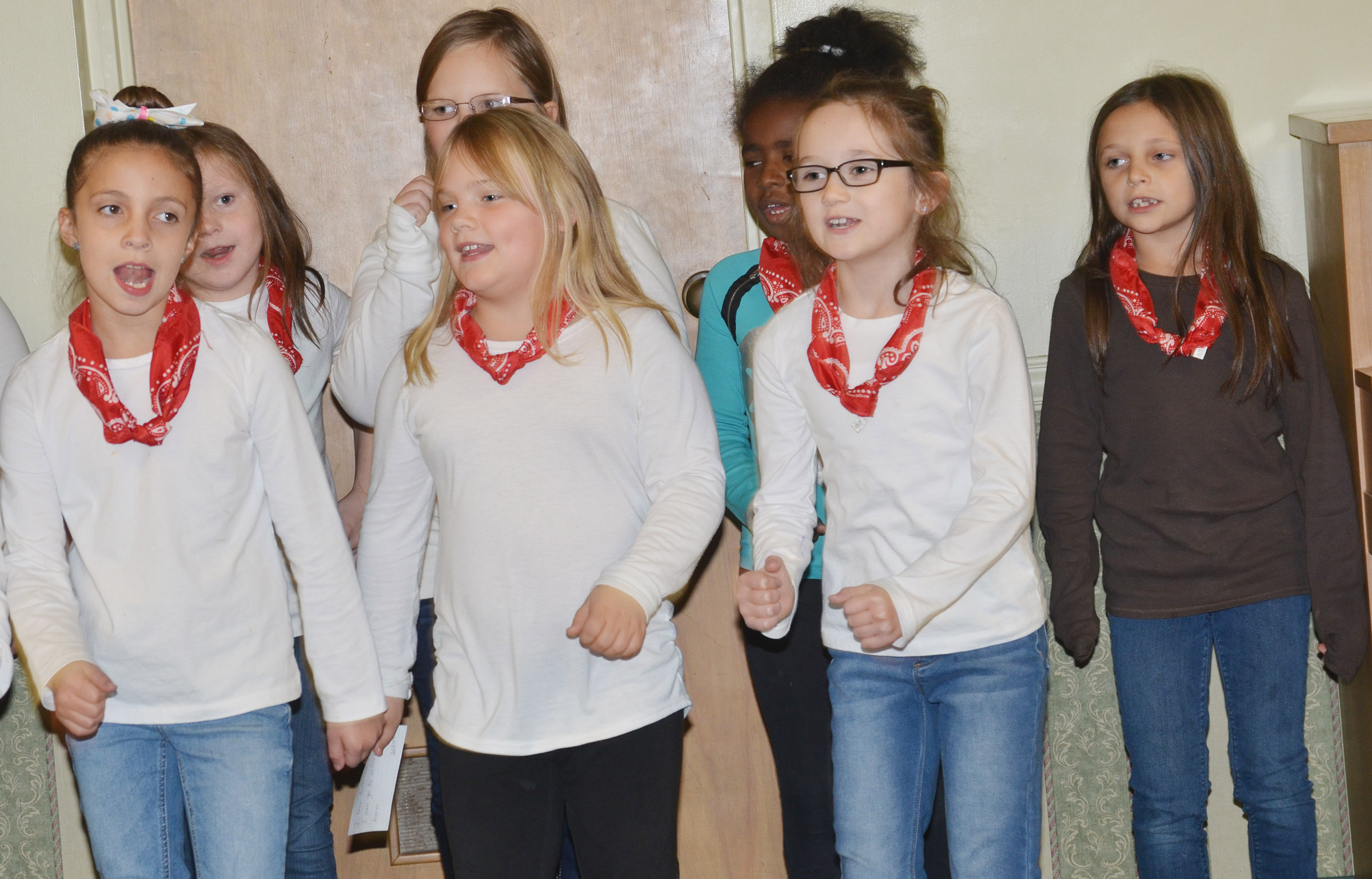 From left, front, CES second-graders Lillian Martin, Addysen England, Anna Keith and Serenity Taylor sing.