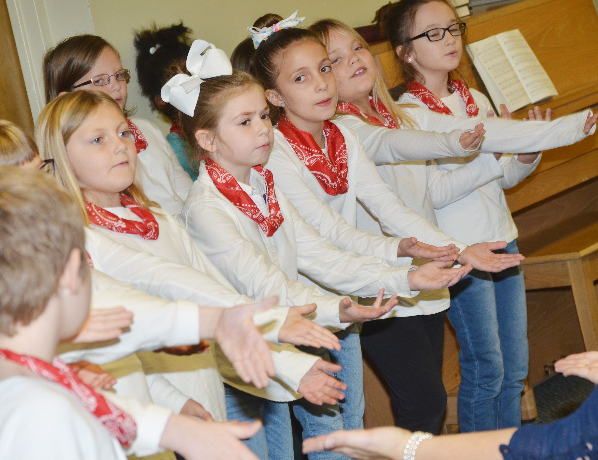 CES second-grade choir members, from left, Asia Singleton, Lainey Price, Lillian Martin, Addysen England Anna Keith sing.
