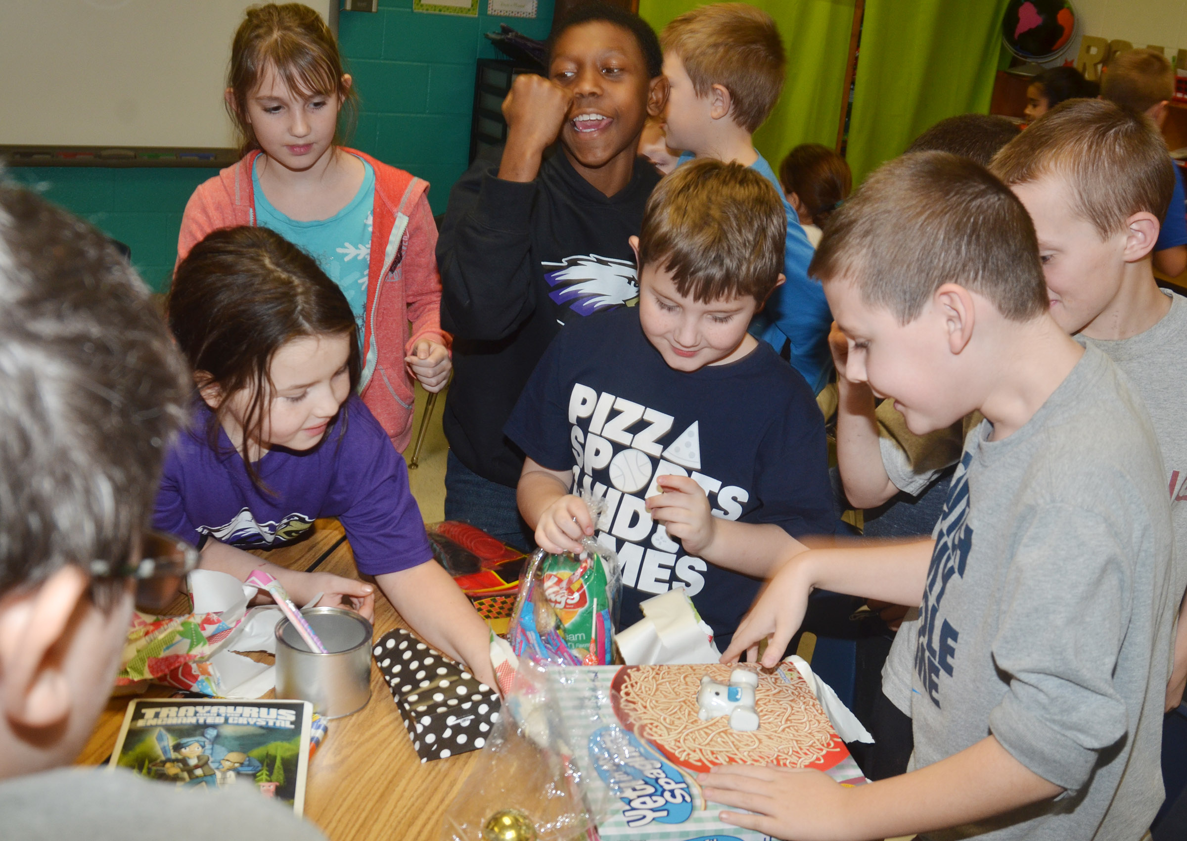 CES third-graders in Hannah Jones's class are excited to see one of the gifts that Santa brought them.