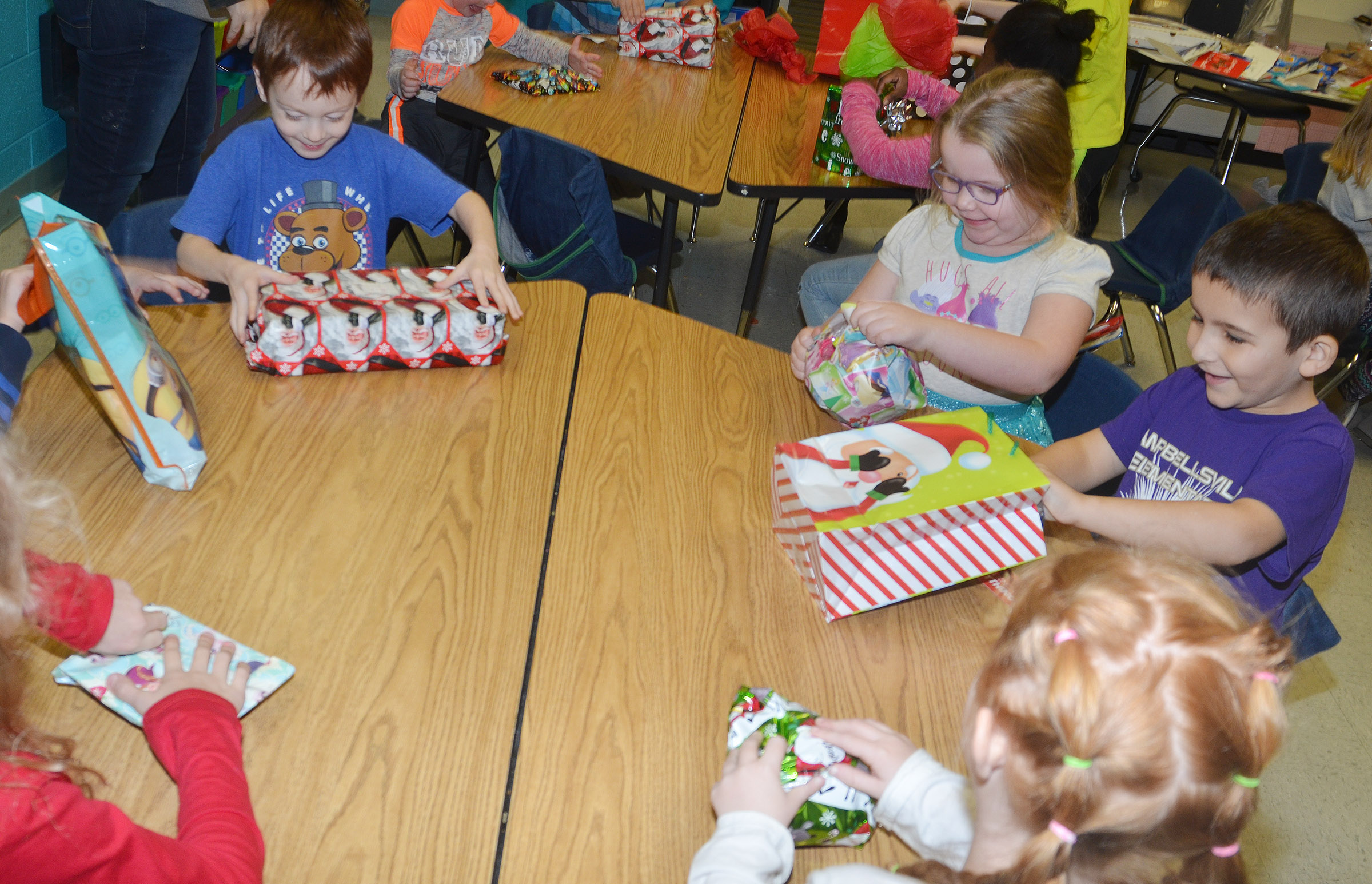 CES first-graders in Amanda Greer's class open the presents they received in their class gift exchange.