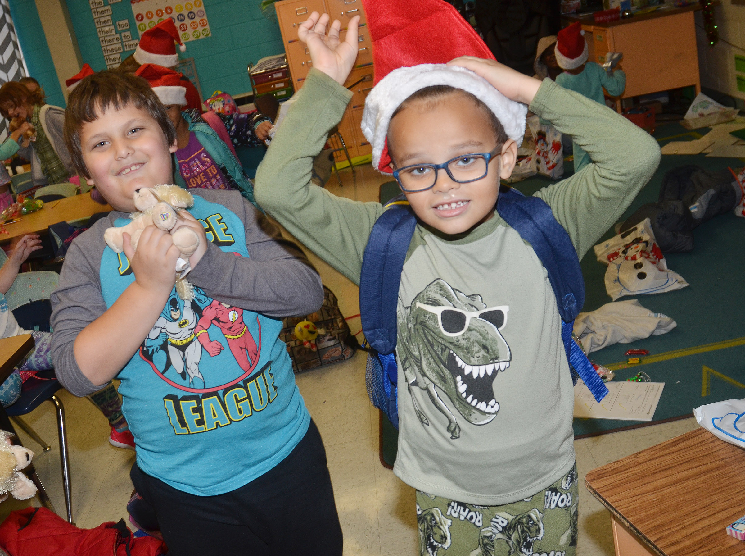 CES first-graders Cloud Malone, at left, and Davian Taylor have fun at their class Christmas party.
