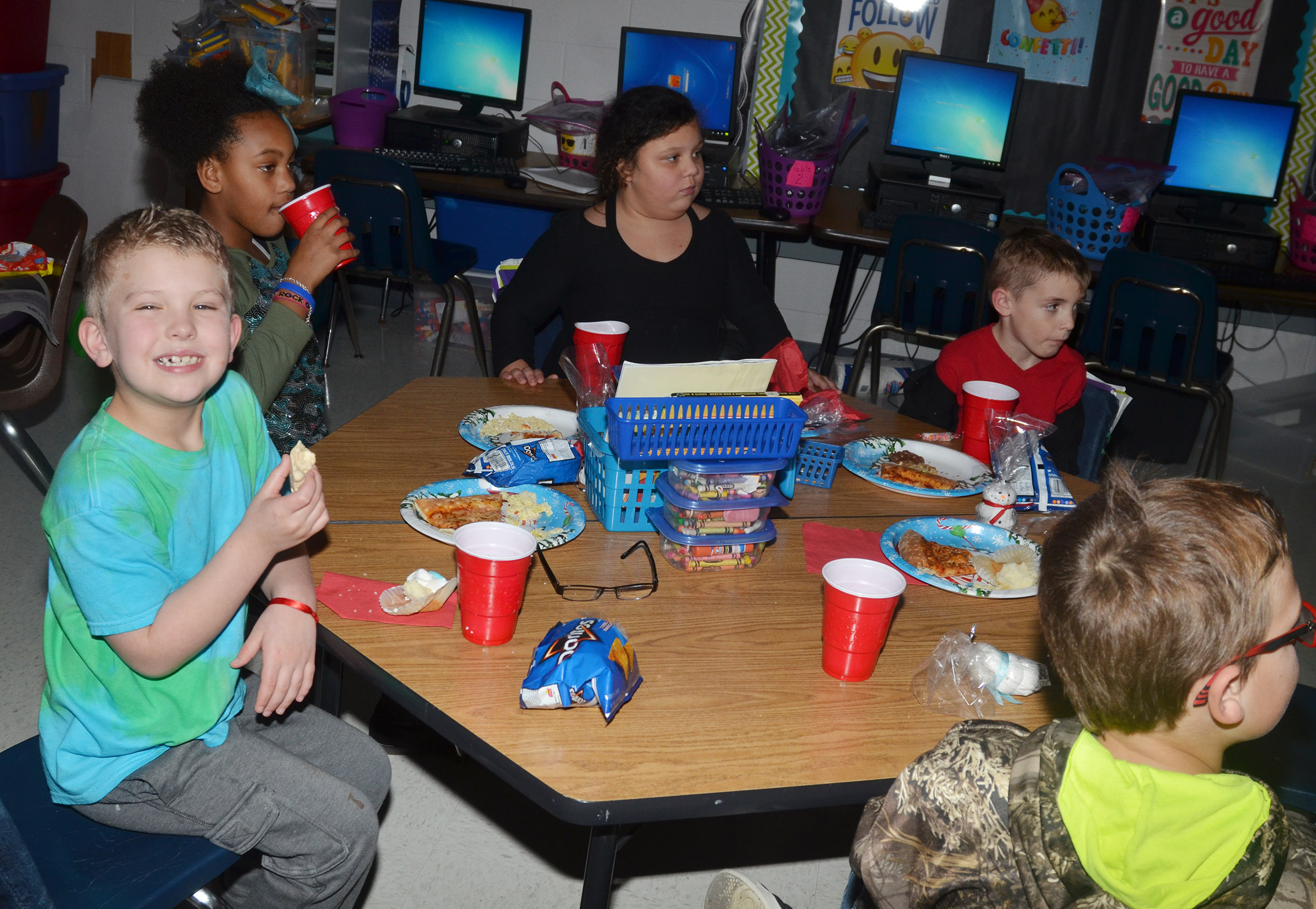 CES second-graders in Tracey Rinehart's class enjoy some special Christmas treats.
