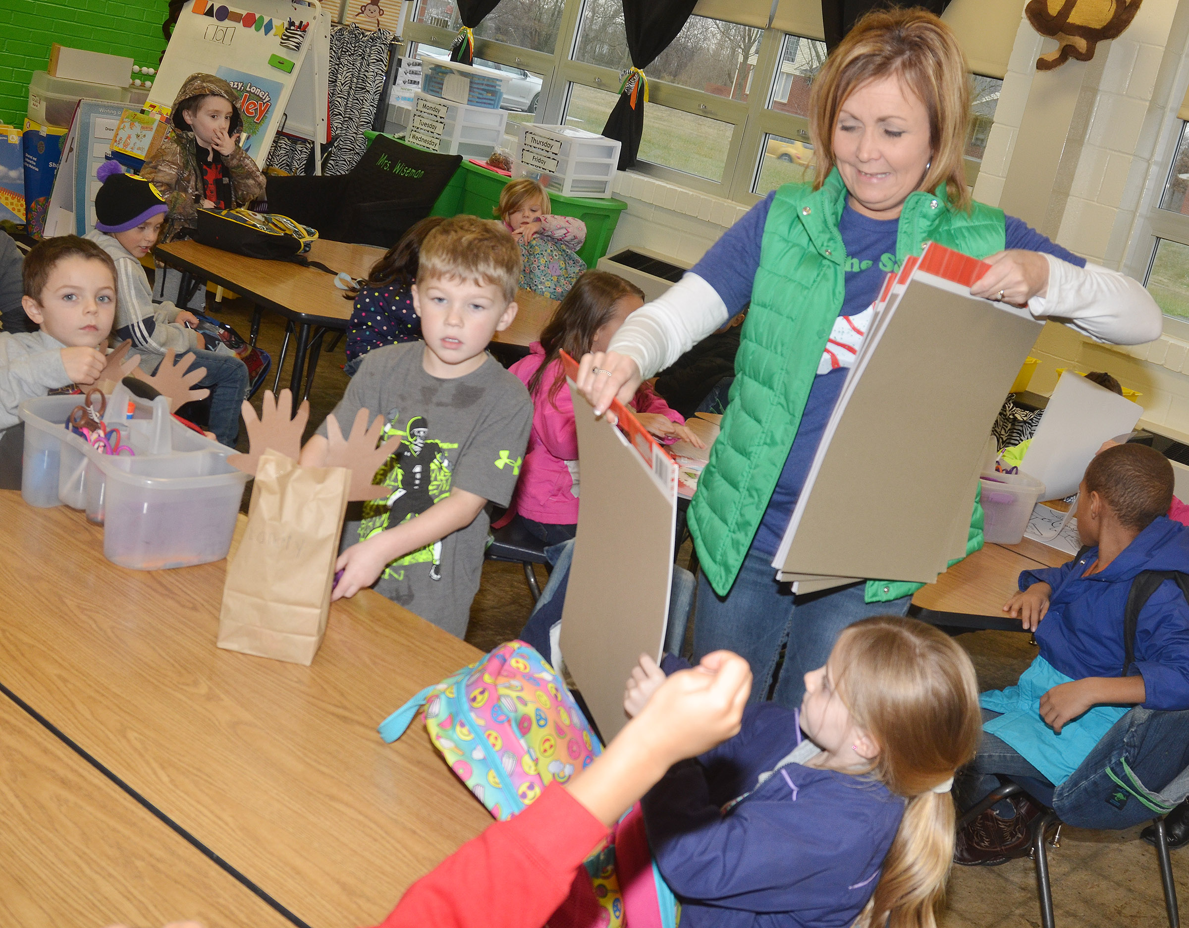 CES kindergarten teacher Lisa Wiseman passes out gifts to her students.