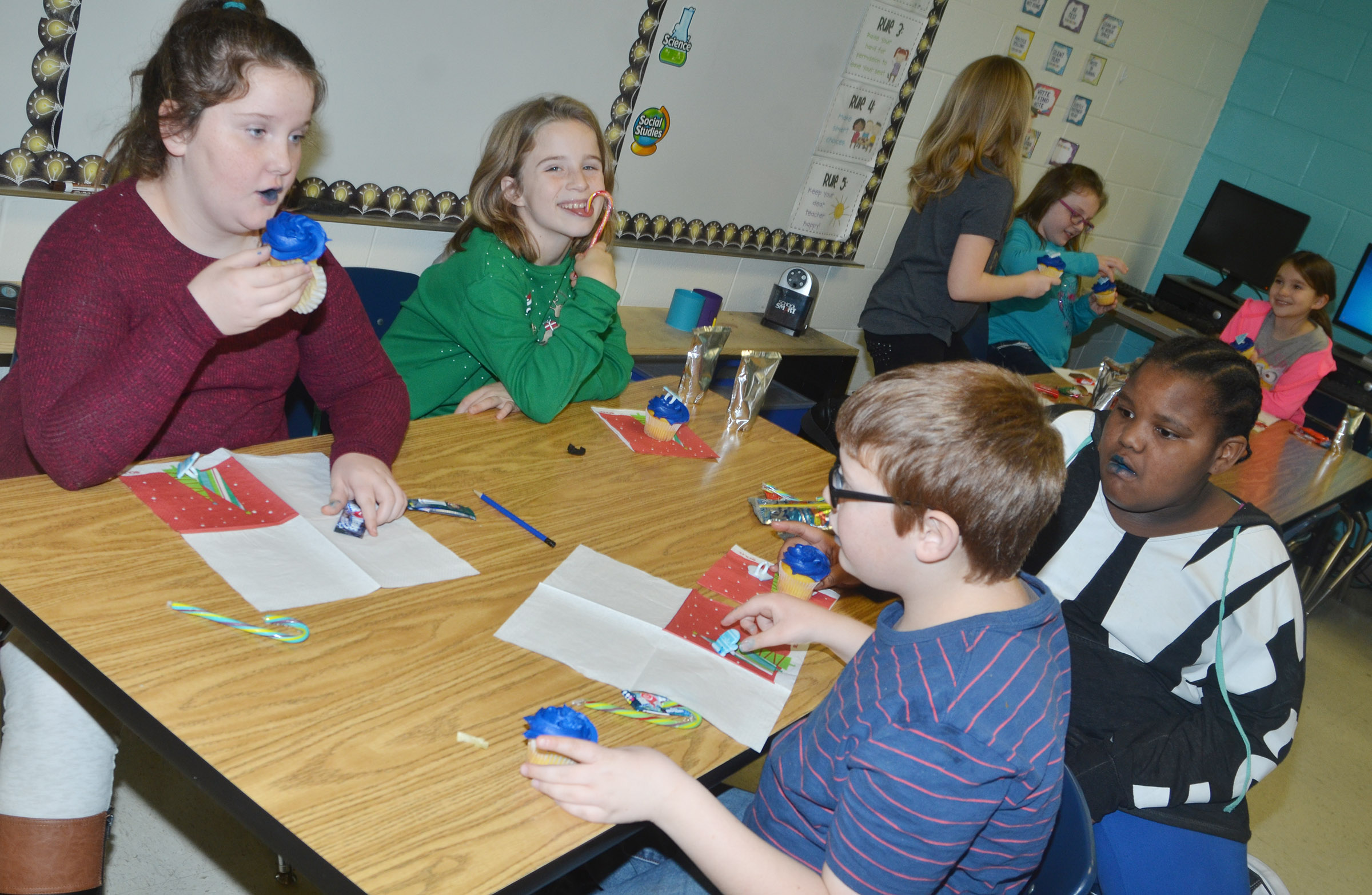 CES fourth-graders in Samantha Coomer's leadership class enjoy special Christmas treats.