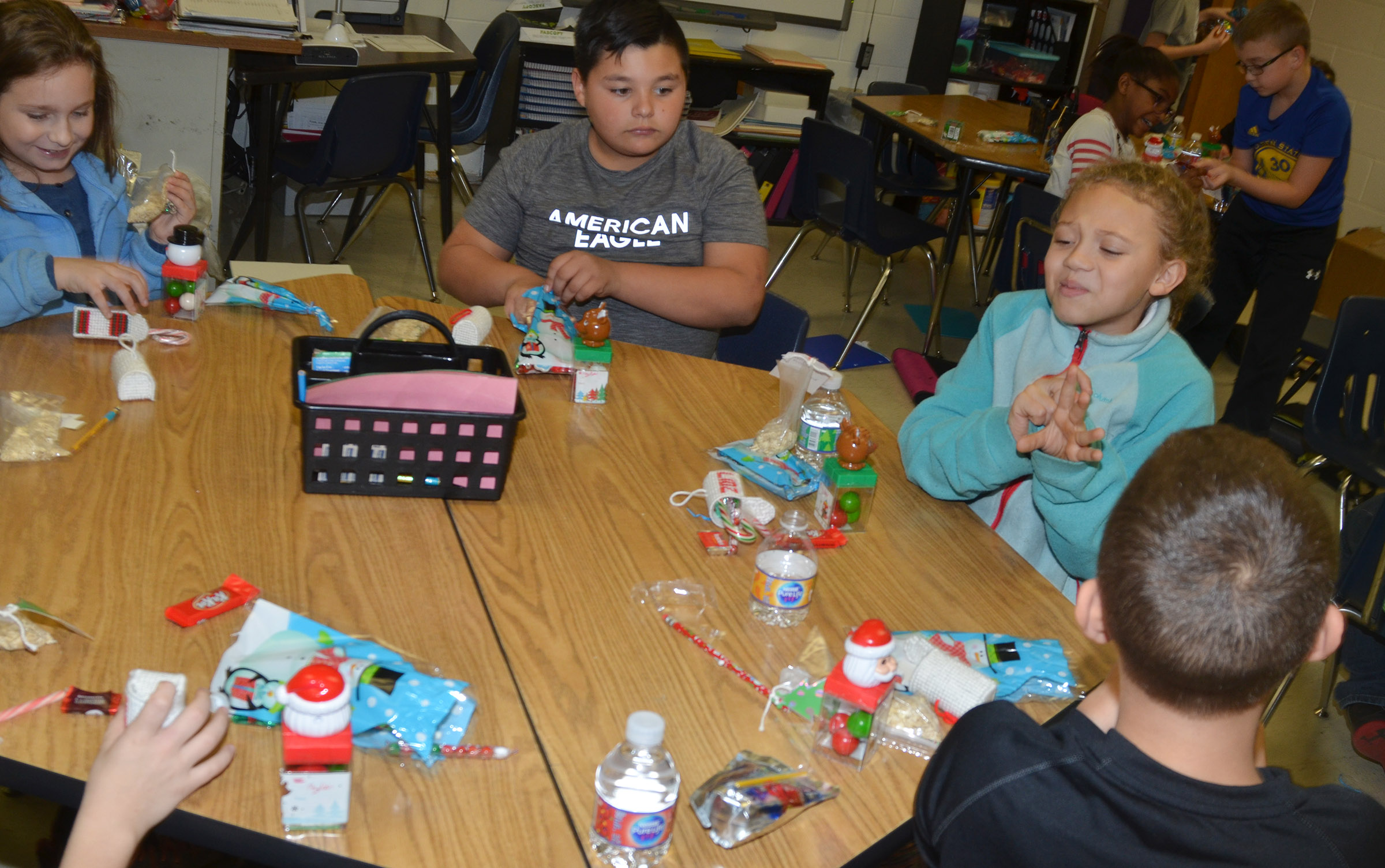 CES fourth-graders in Maranda Wright's leadership class open some special gifts from Santa.