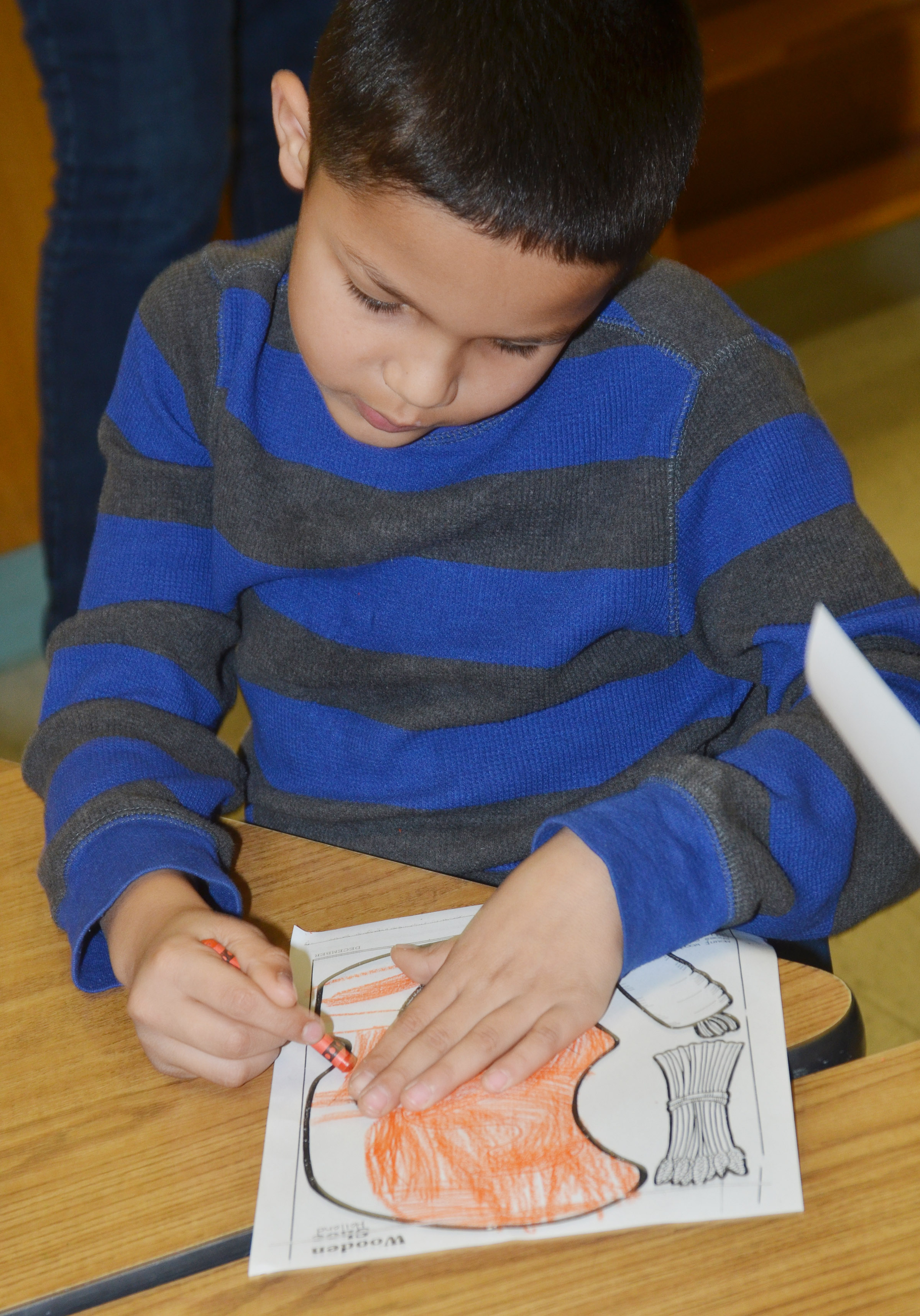 CES second-grader Makyian Bridgewater colors his wooden shoe after learning about the holiday traditions in the Netherlands.
