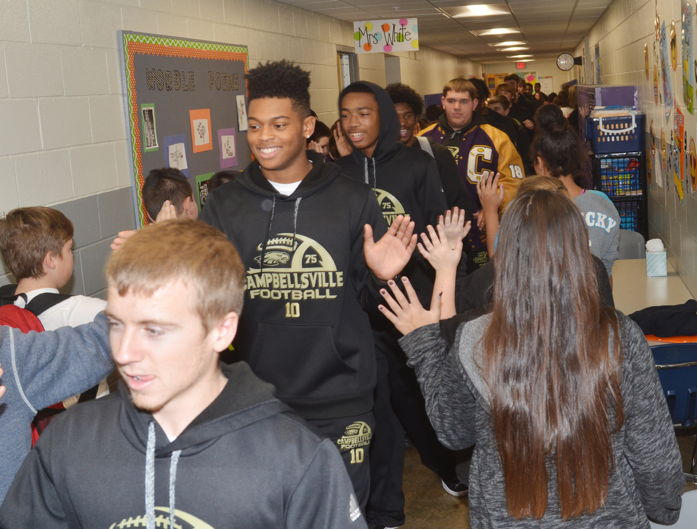 CHS senior Devonte Cubit leads his teammates down the CES hallway.