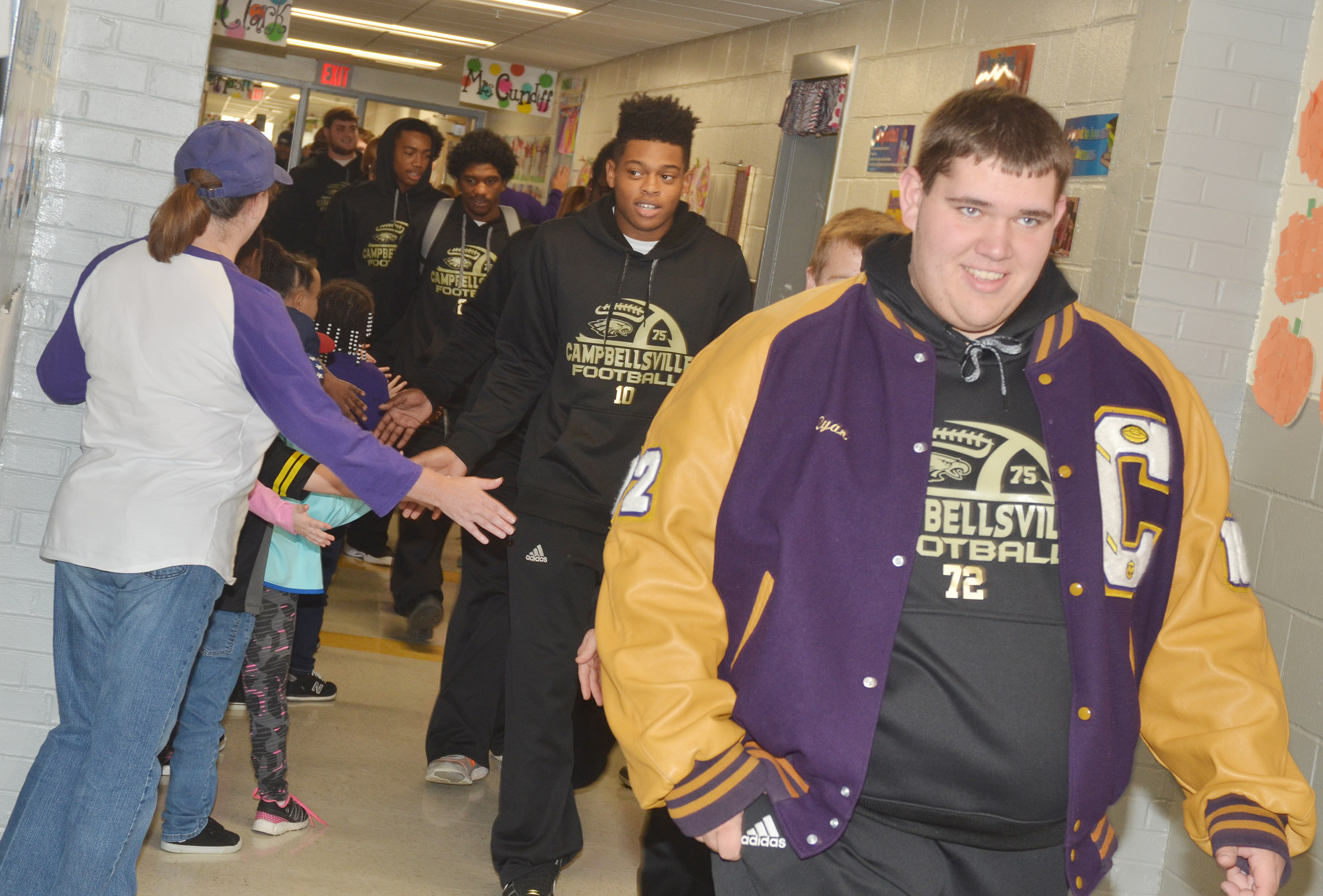 CHS senior Ryan Wiedewitsch leads his teammates down the CES hallway.