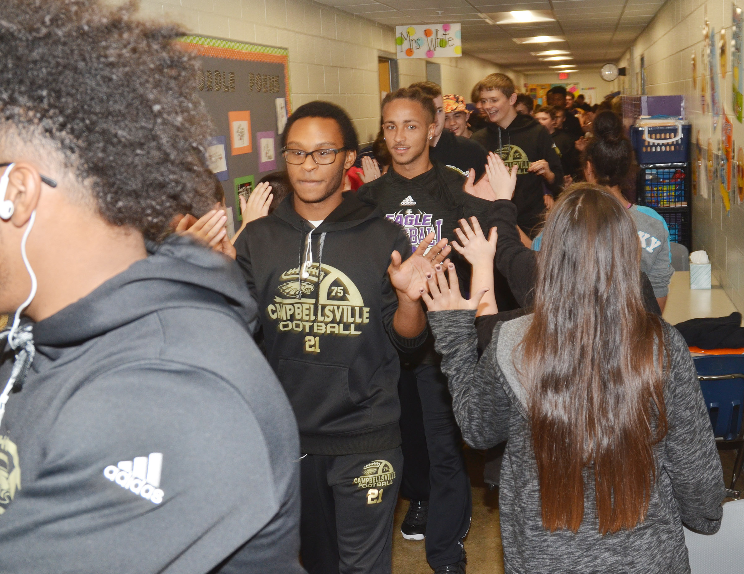 CHS junior Daesean Vancleave leads his teammates down the CES hallway.