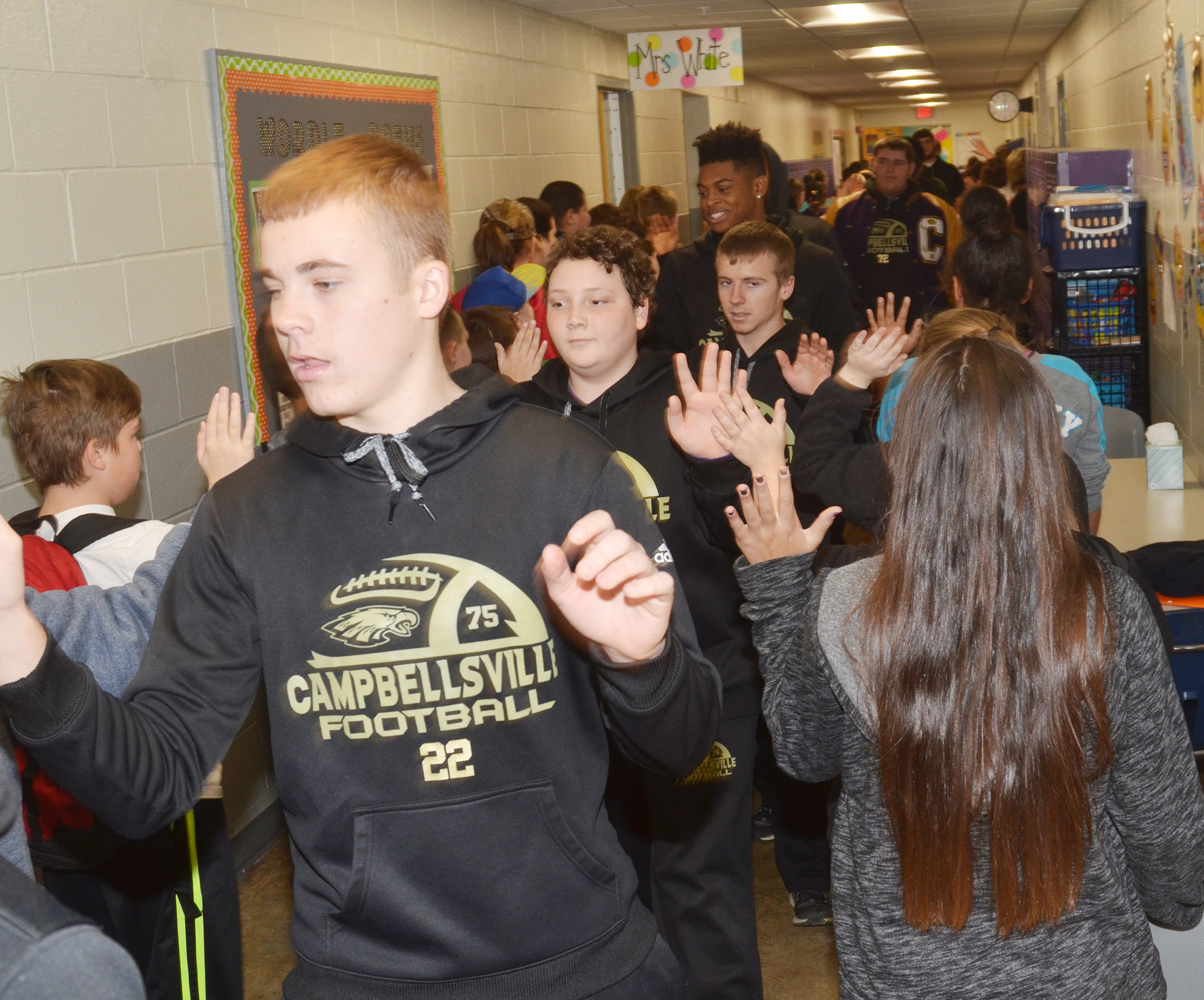 CHS sophomore Tyler Gribbins leads his teammates down the CES hallway.