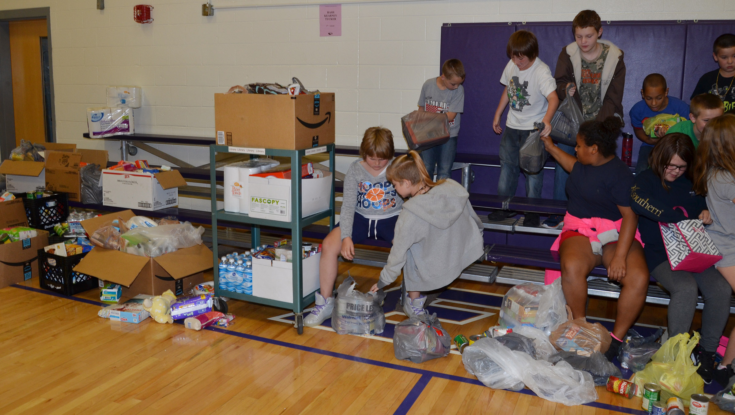 CES fifth-grade students and teachers organize the donations they received in their Hurricane Harvey drive.