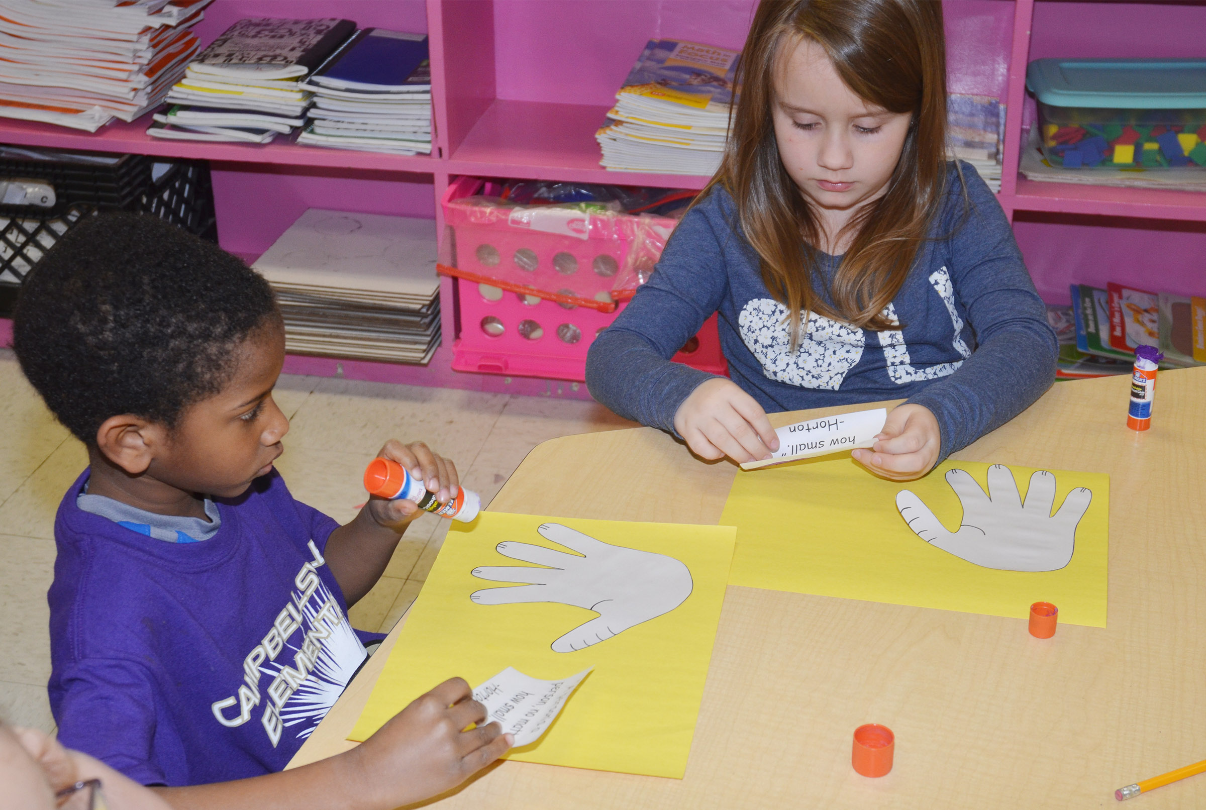 CES kindergarteners Kasen Smith, at left, and Natalee Shaw put finishing touches on their Horton characters.