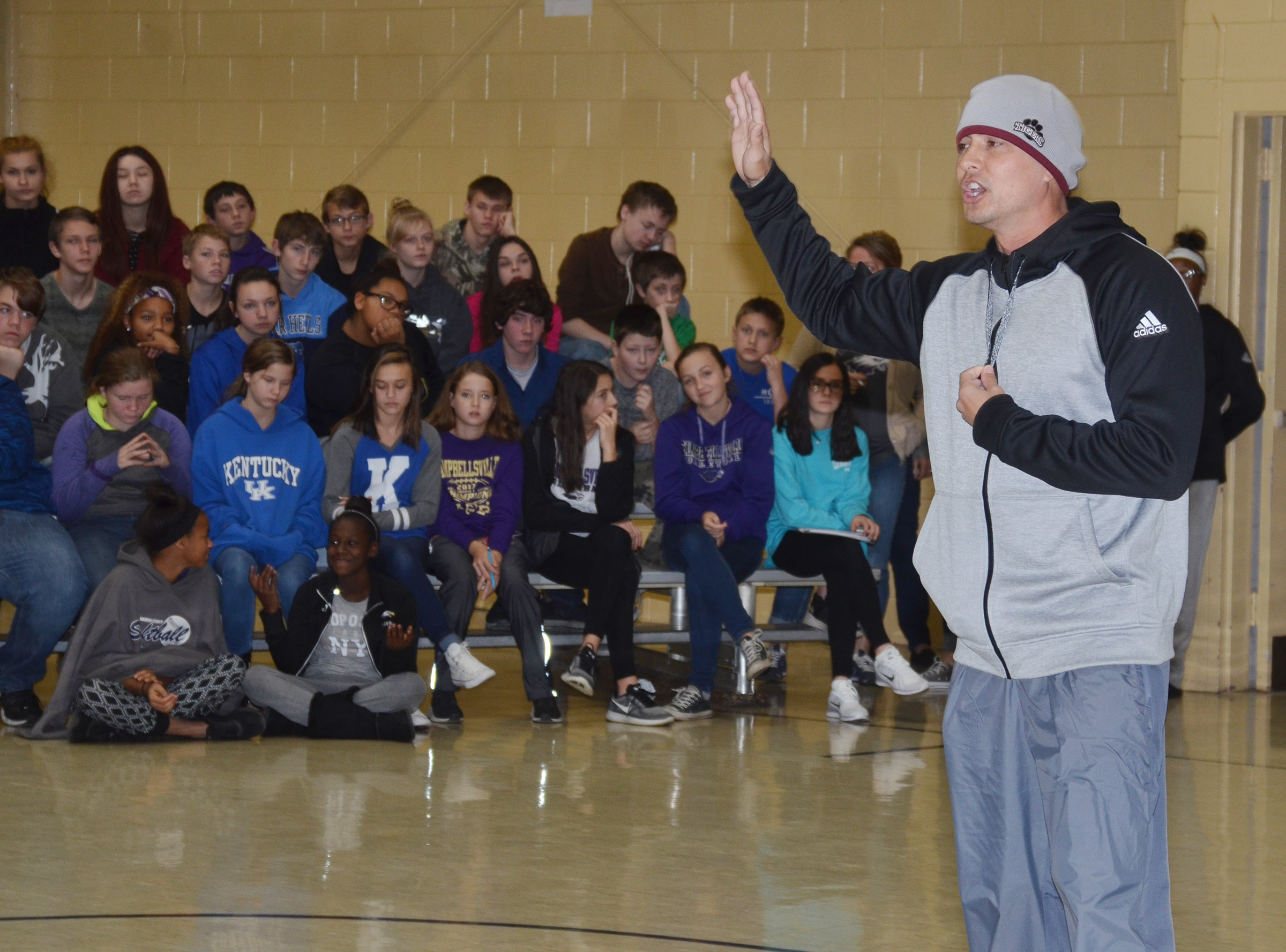 CU assistant football coach Ricky Gehres talks to CMS students.