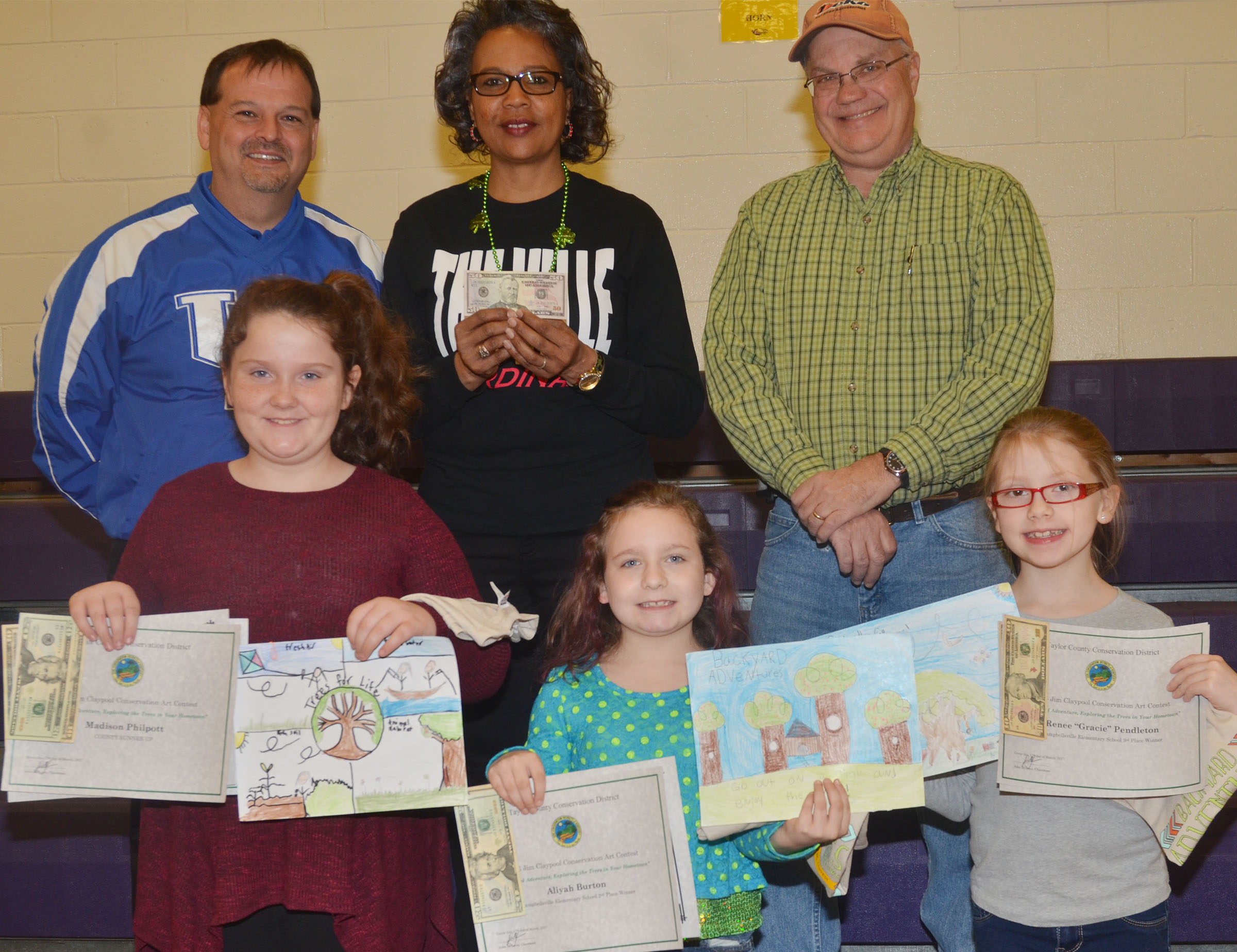 CES overall art competition winners include, from left, front, third-grader Madison Philpott, who was a classroom winner, CES first-place winner and the county runner-up; third-grader Aliyah Burton, who was a classroom winner and the CES second-place winner; and third-grader Gracie Pendleton, who was a classroom winner and the CES third-place winner. Back, CES Principal Ricky Hunt, third-grade teacher Doretha Sanders, who, as Philpott's teacher, receives $50 for classroom supplies, and Taylor County Conservation District Board Member Barry Smith.