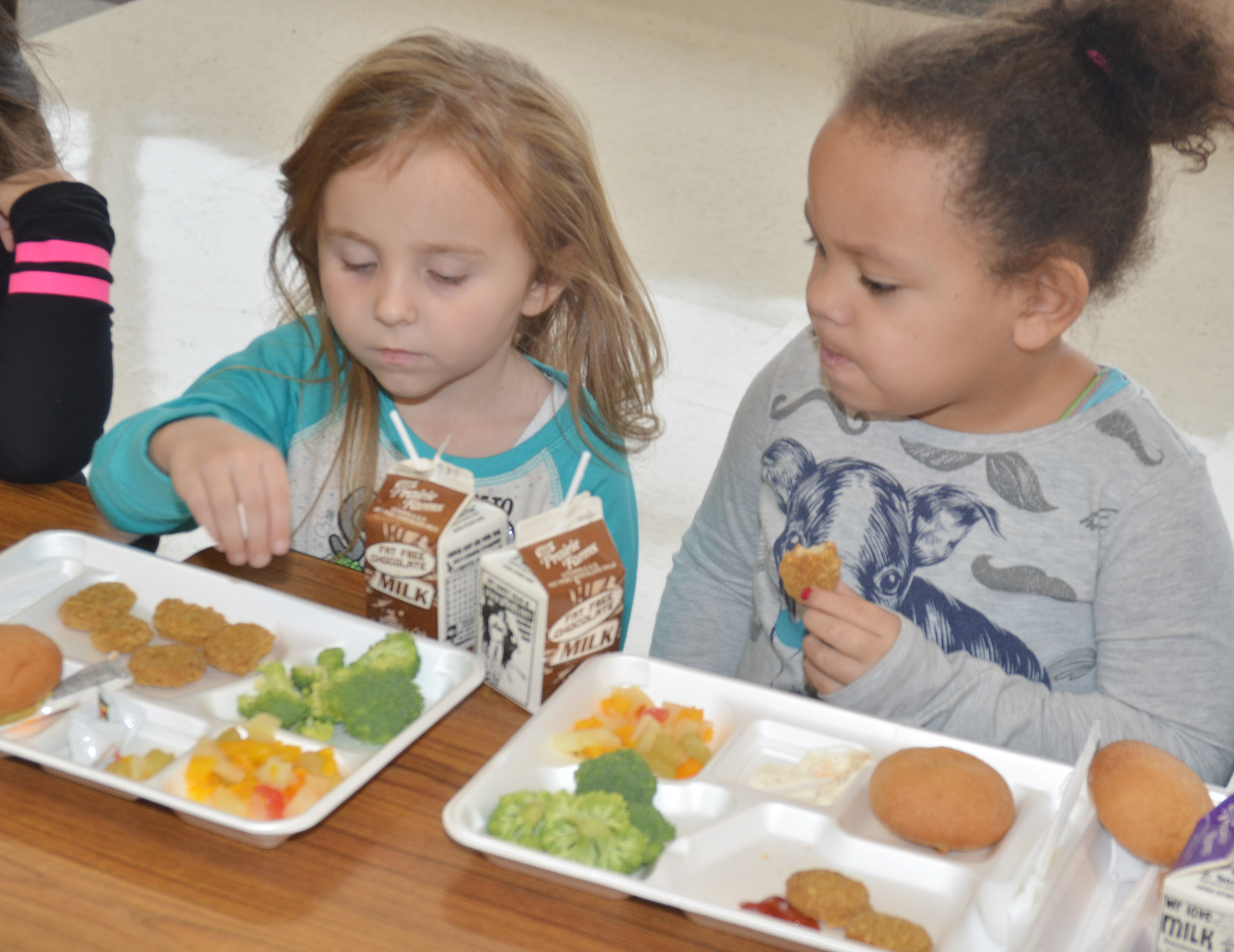 CES preschool students Tabitha Leggett, at left, and Lillian Merriweather were among the first group of students to use the school's new cafeteria.
