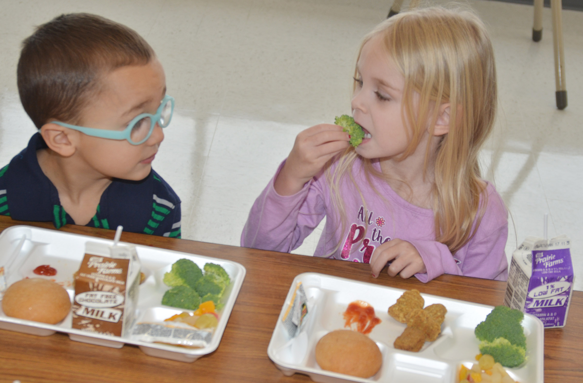 CES preschool students Chanler Mann, at left, and Alinna Bray were among the first group of students to use the school's new cafeteria.