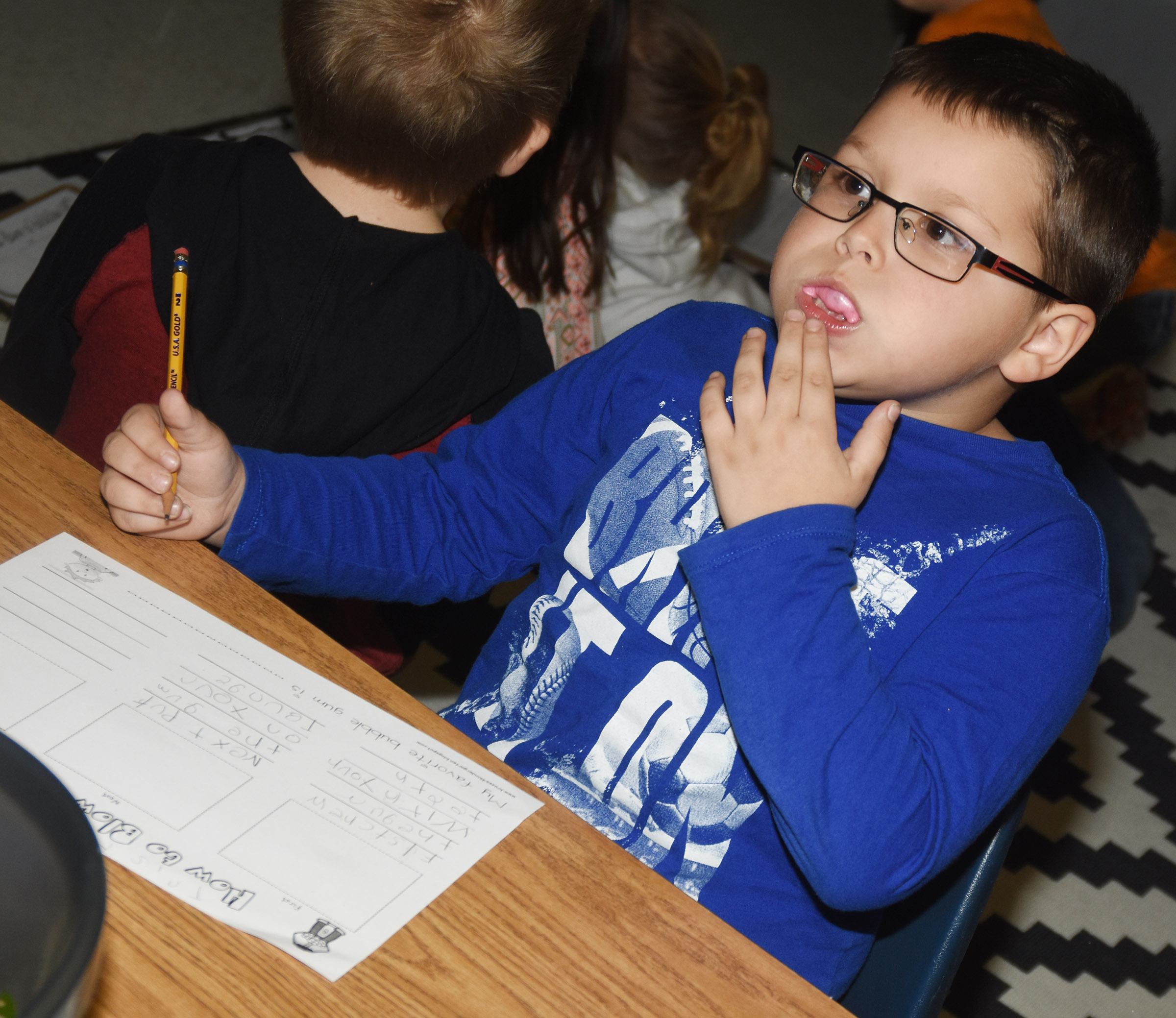 CES first-grader Tristan Burton tries to blow a bubble.