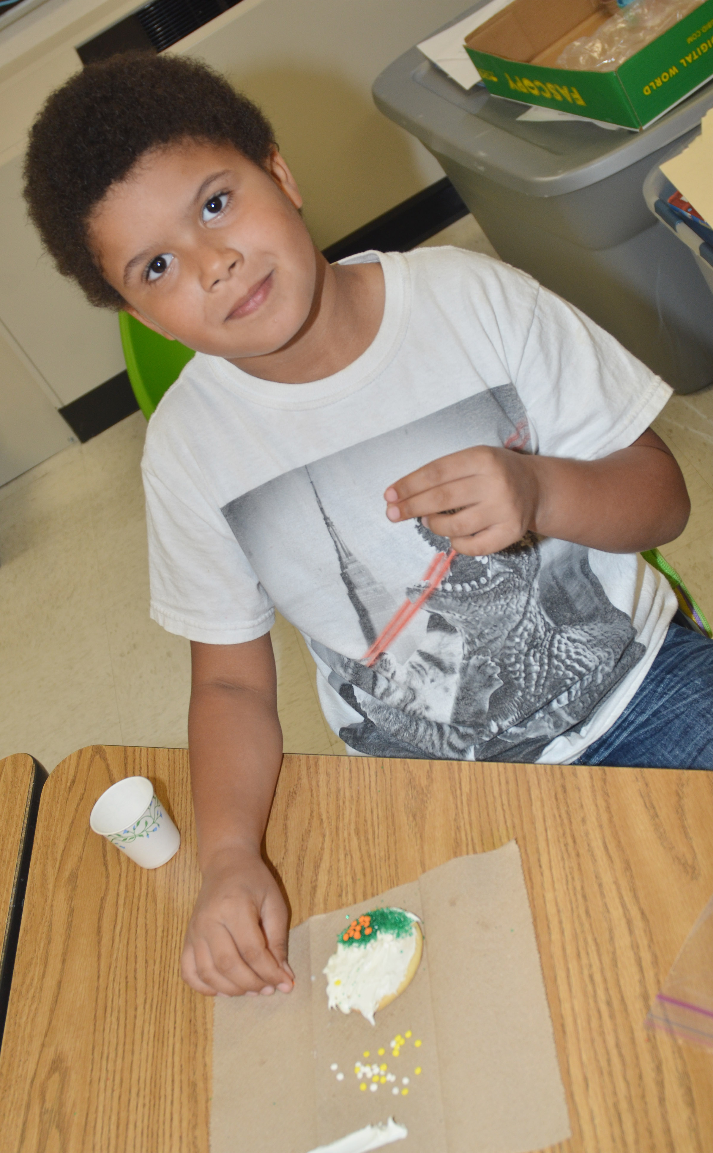 CES first-grader Navon Copeland samples his sprinkles.