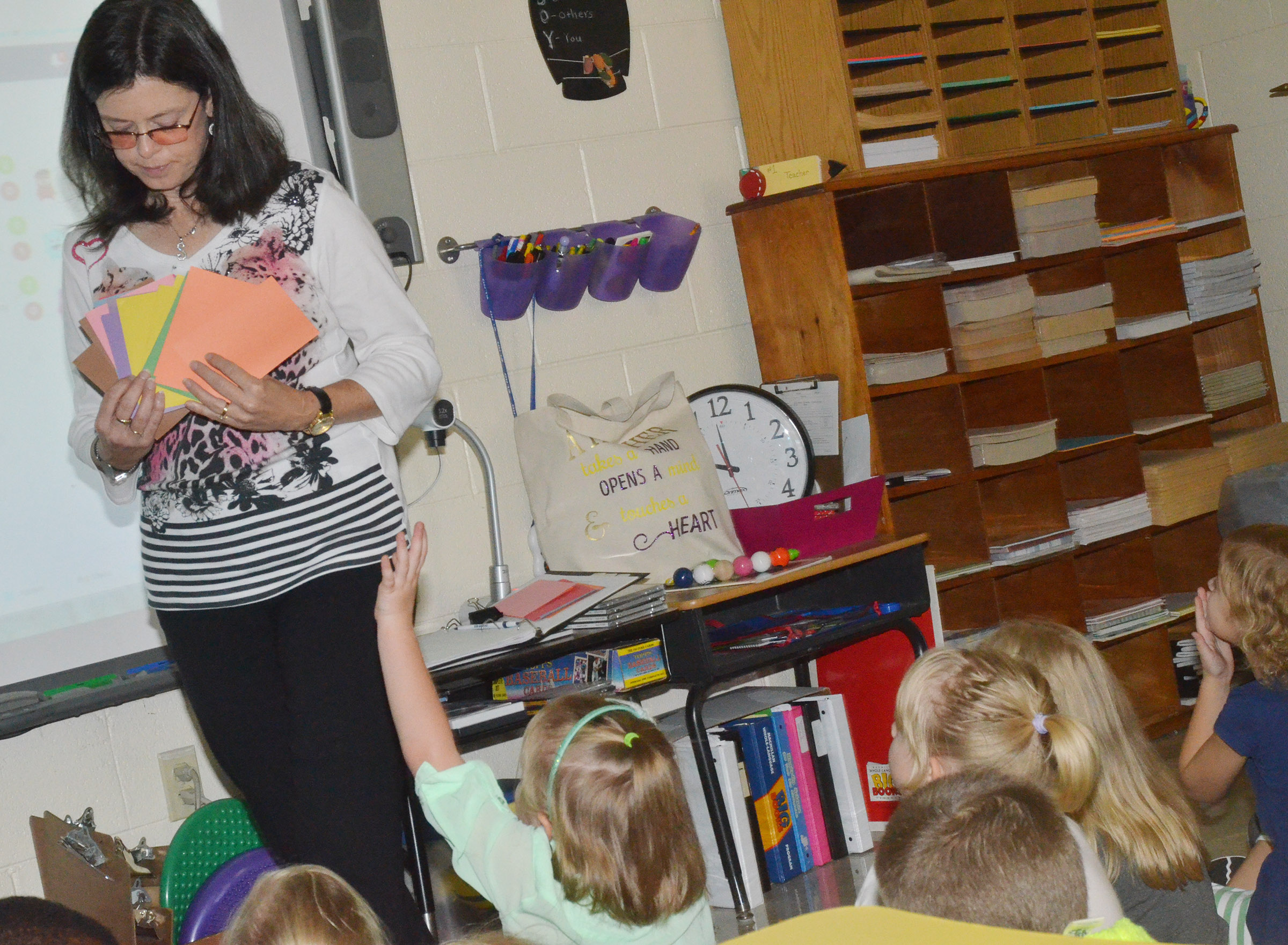 CES writing teacher Shirley Cox talks about colors with kindergarten students.