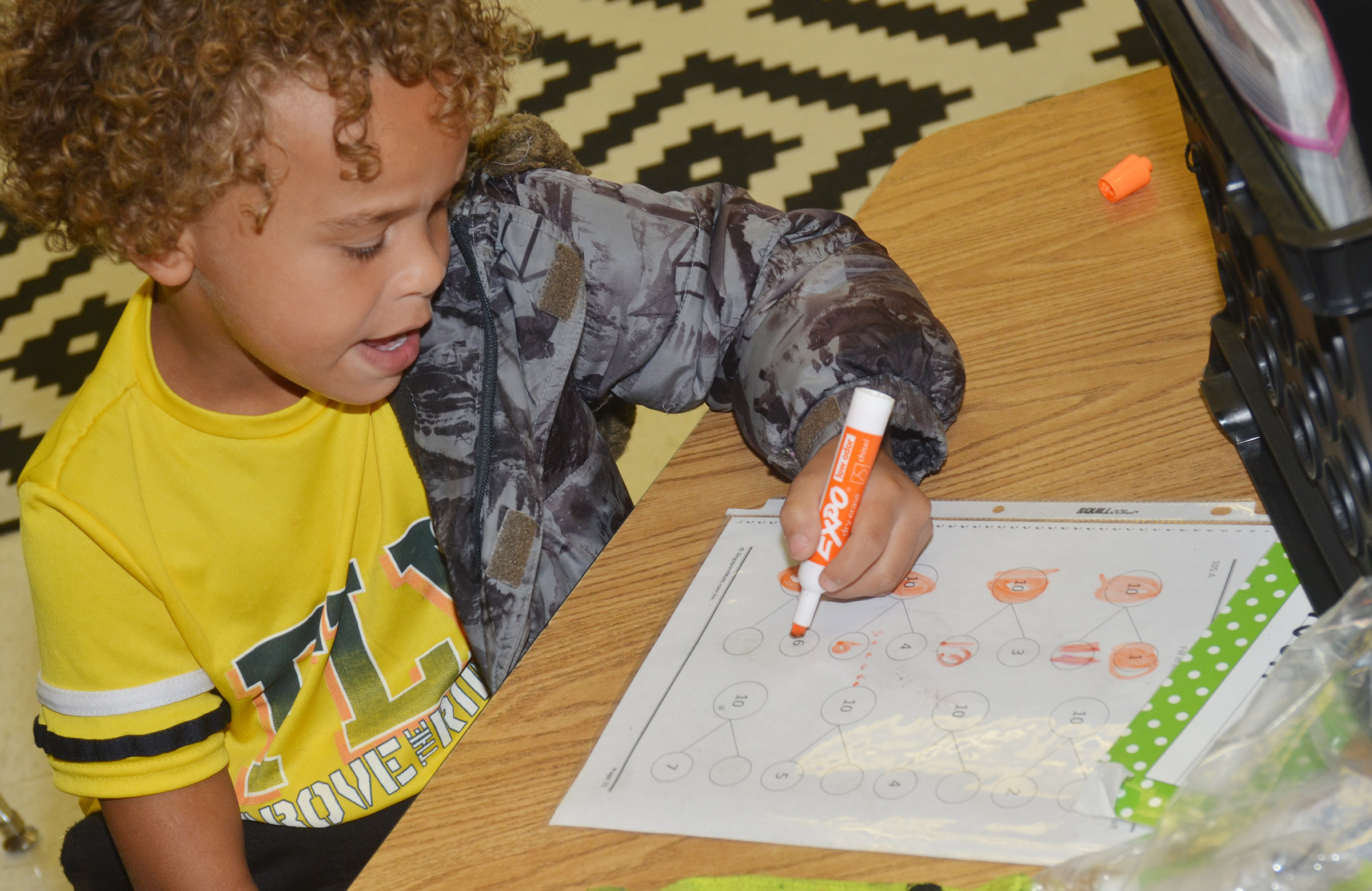 CES first-grader Dyra Welch finds numbers that add together to make 10.