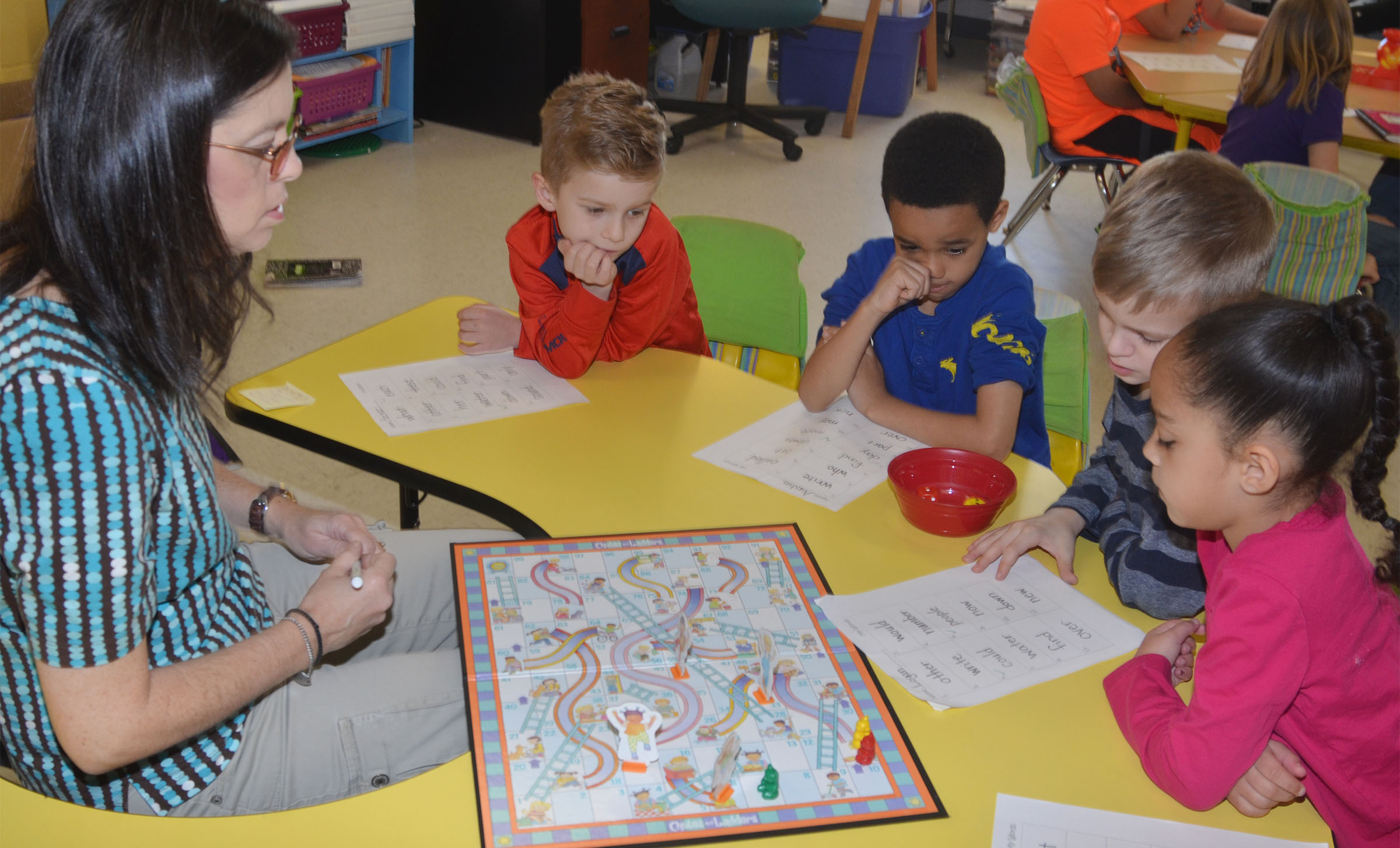 CES first-grade teacher Shirley Cox plays Candyland with students, from left, Parker Hamilton, Austin Hamilton, Logan Weddle and Essence Hunter to help them learn sight words.
