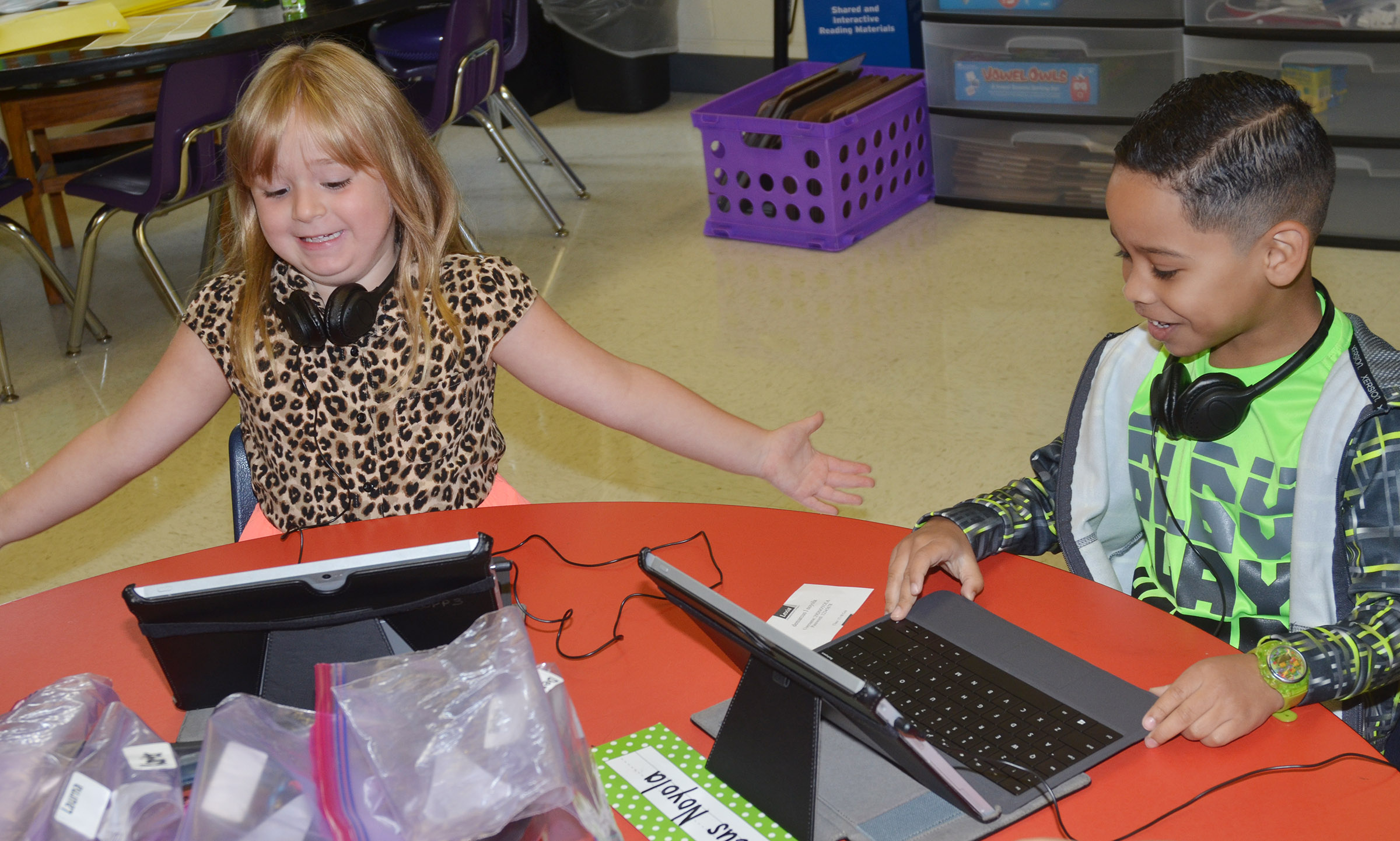 CES first-graders Briley Sapp, at left, and Demarcus Noyola are excited when their tablets are turned on.