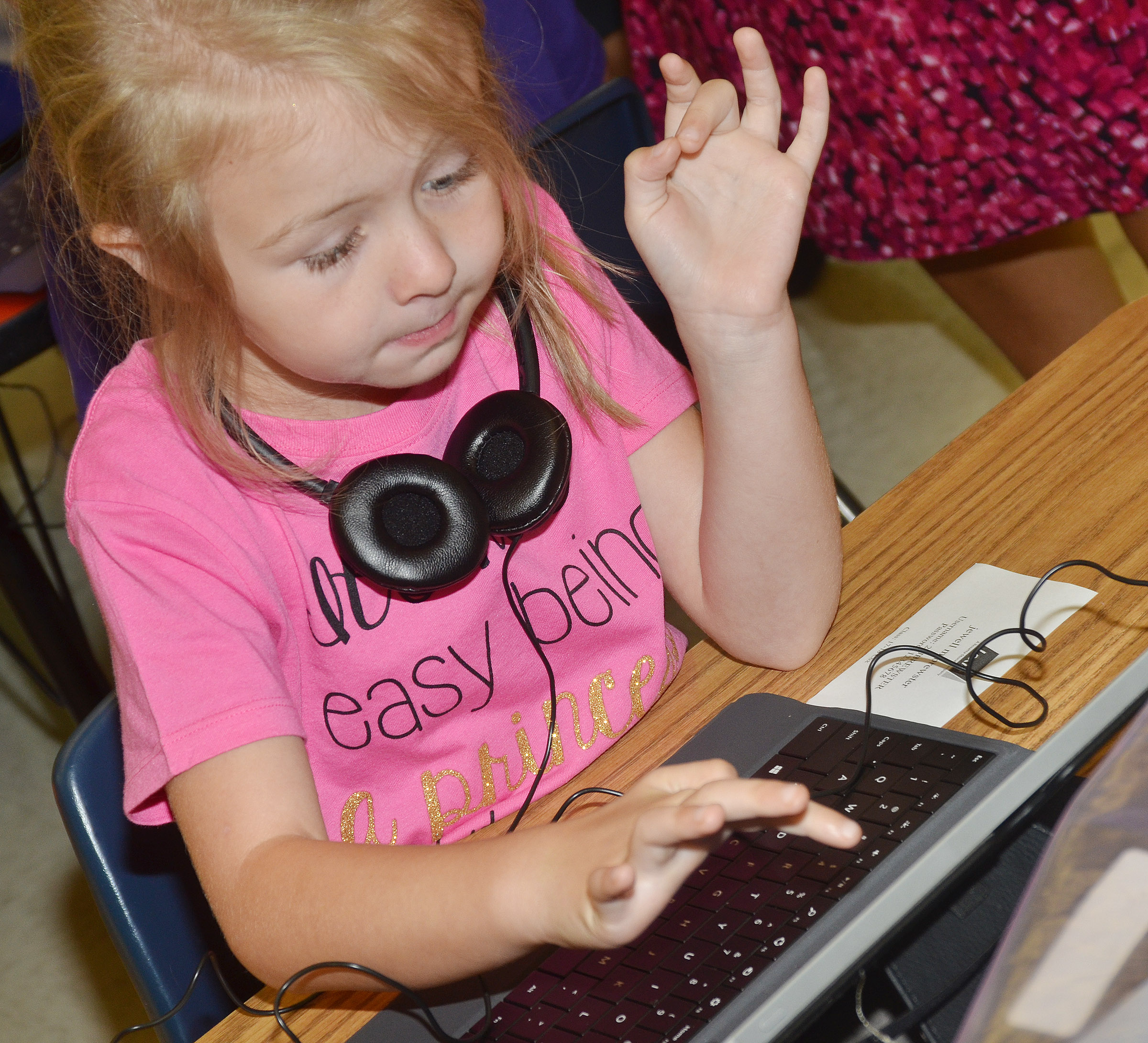 CES first-grader Jewell Brewster types her username as she logs on her tablet.