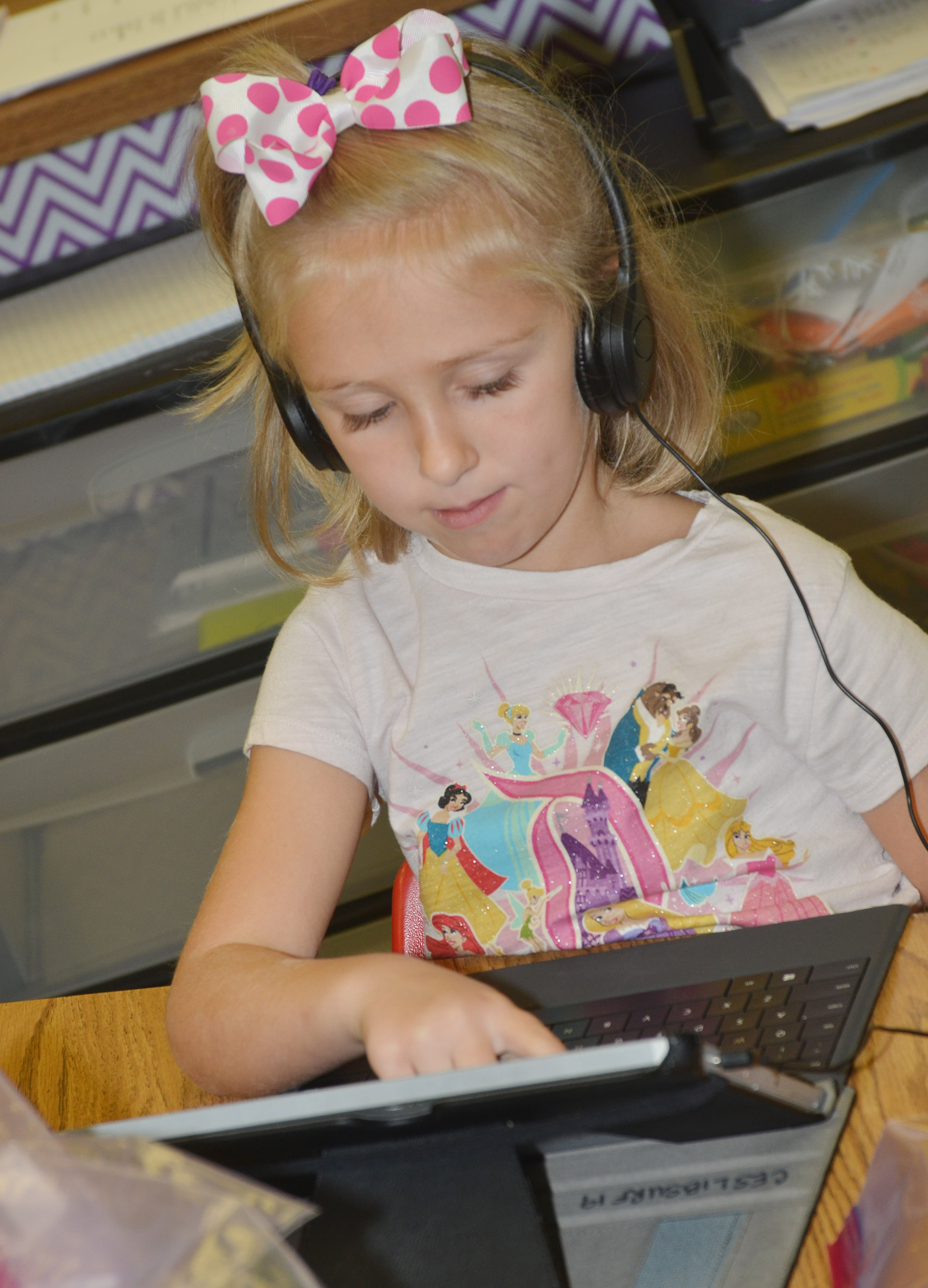 CES first-grader LeeAnna Garvin logs on to the Lexia program.