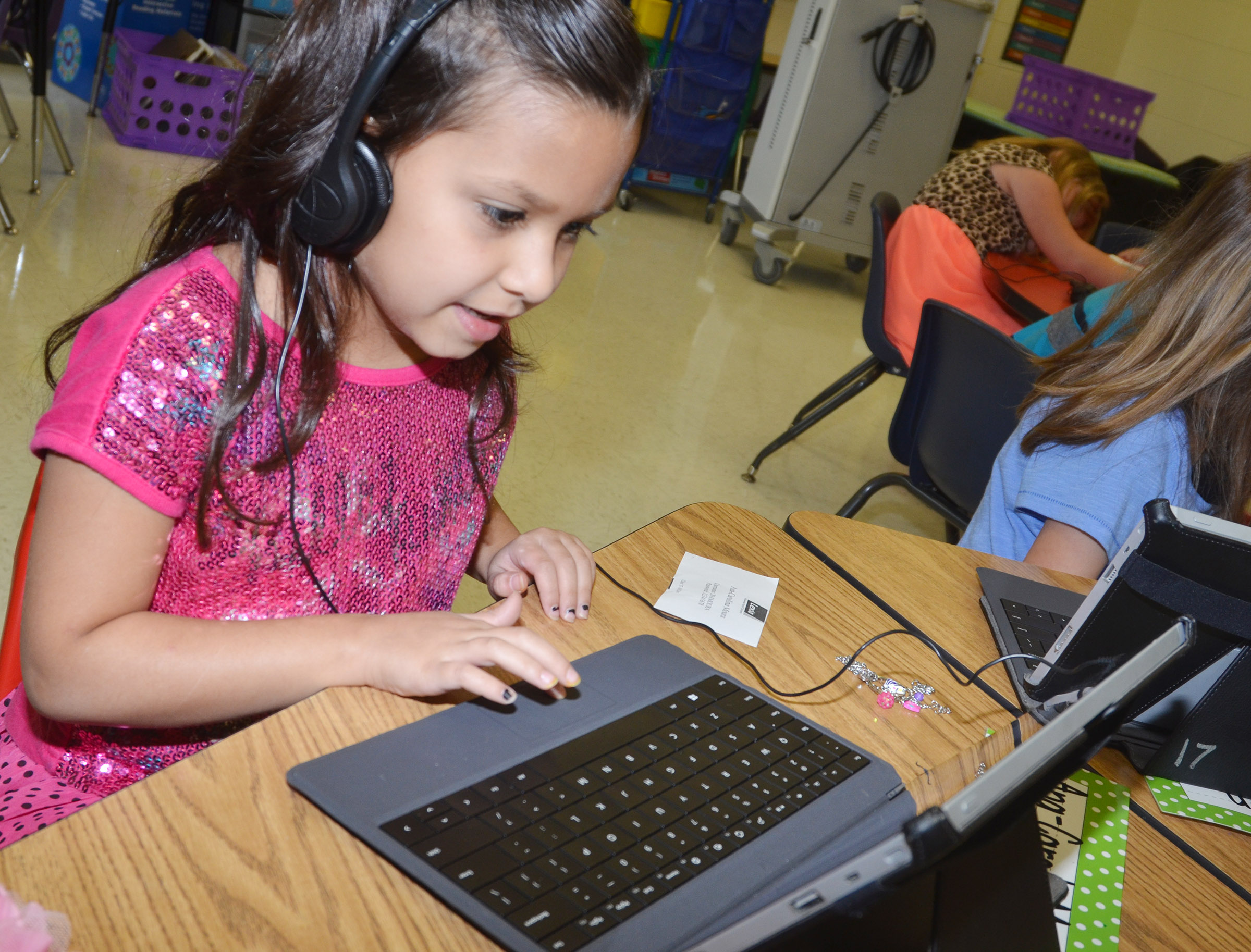 CES first-grader Carol Moura uses the Lexia program.