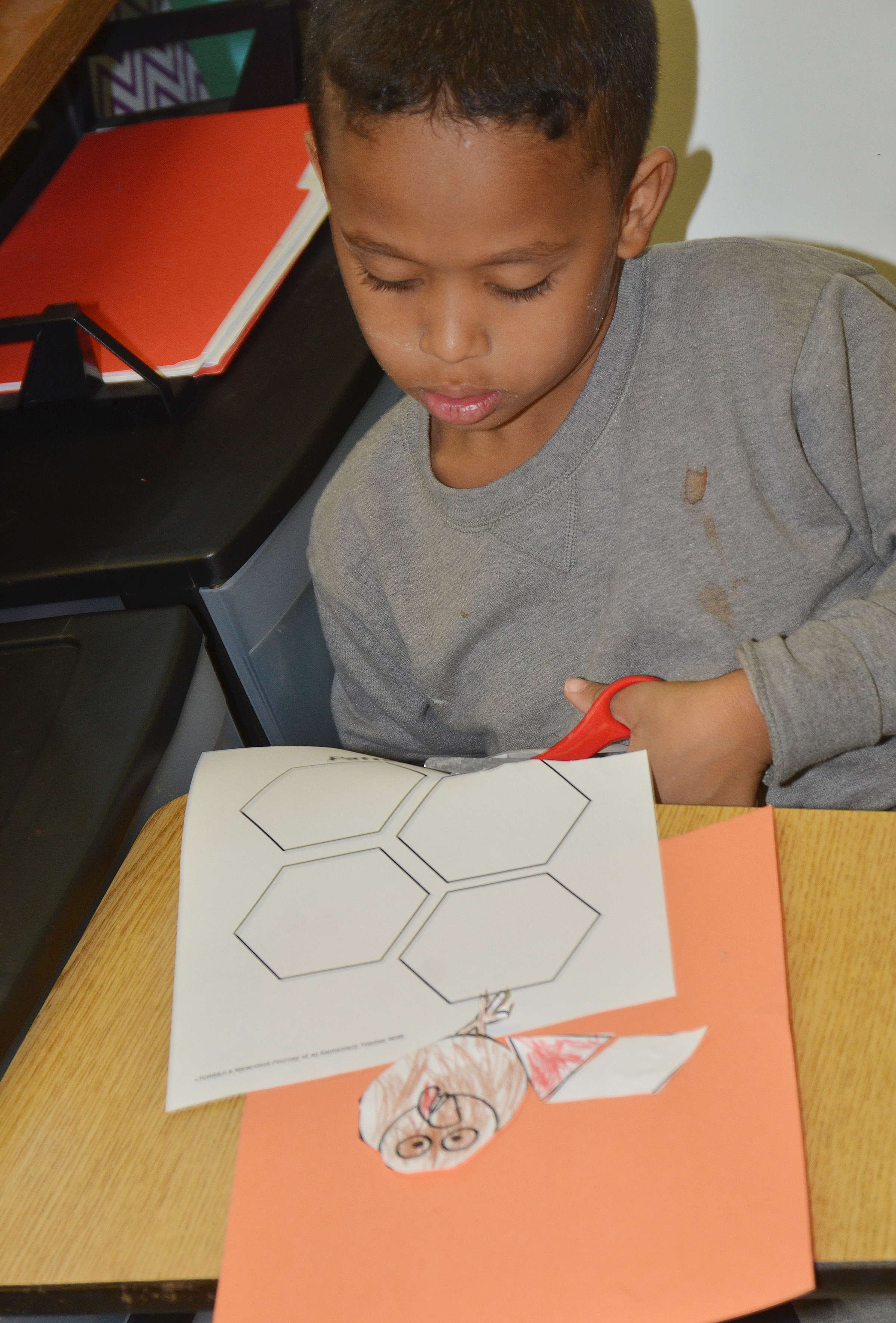 CES first-grader Gabriel Jolivert cuts out shapes to create his turkey feathers.